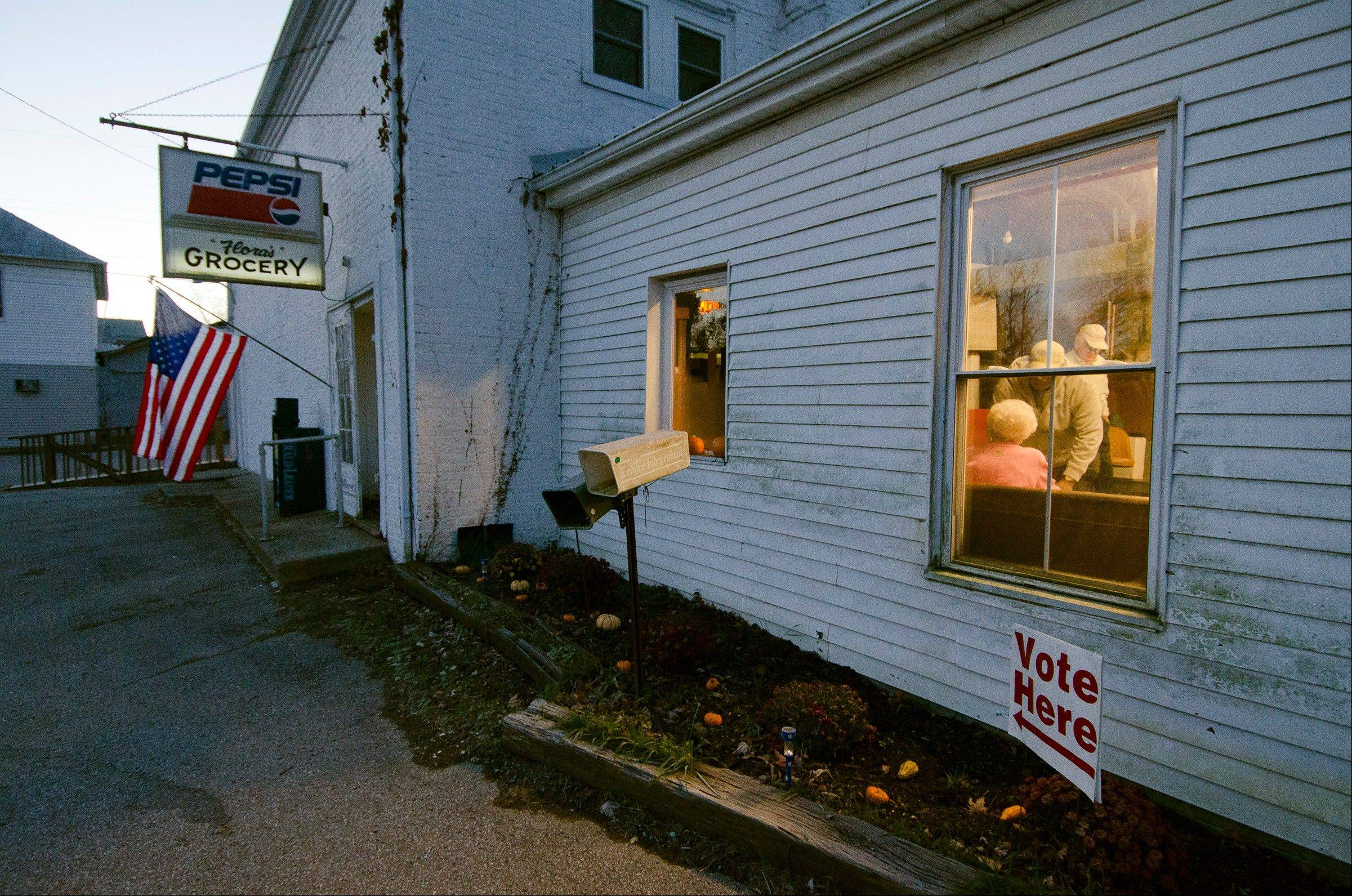 People sign in to vote Tuesday, Nov. 6, 2012 at the Elizaville precinct in Elizaville, Ky. The precinct is located in a general store built in 1821 and has 524 registered voters.