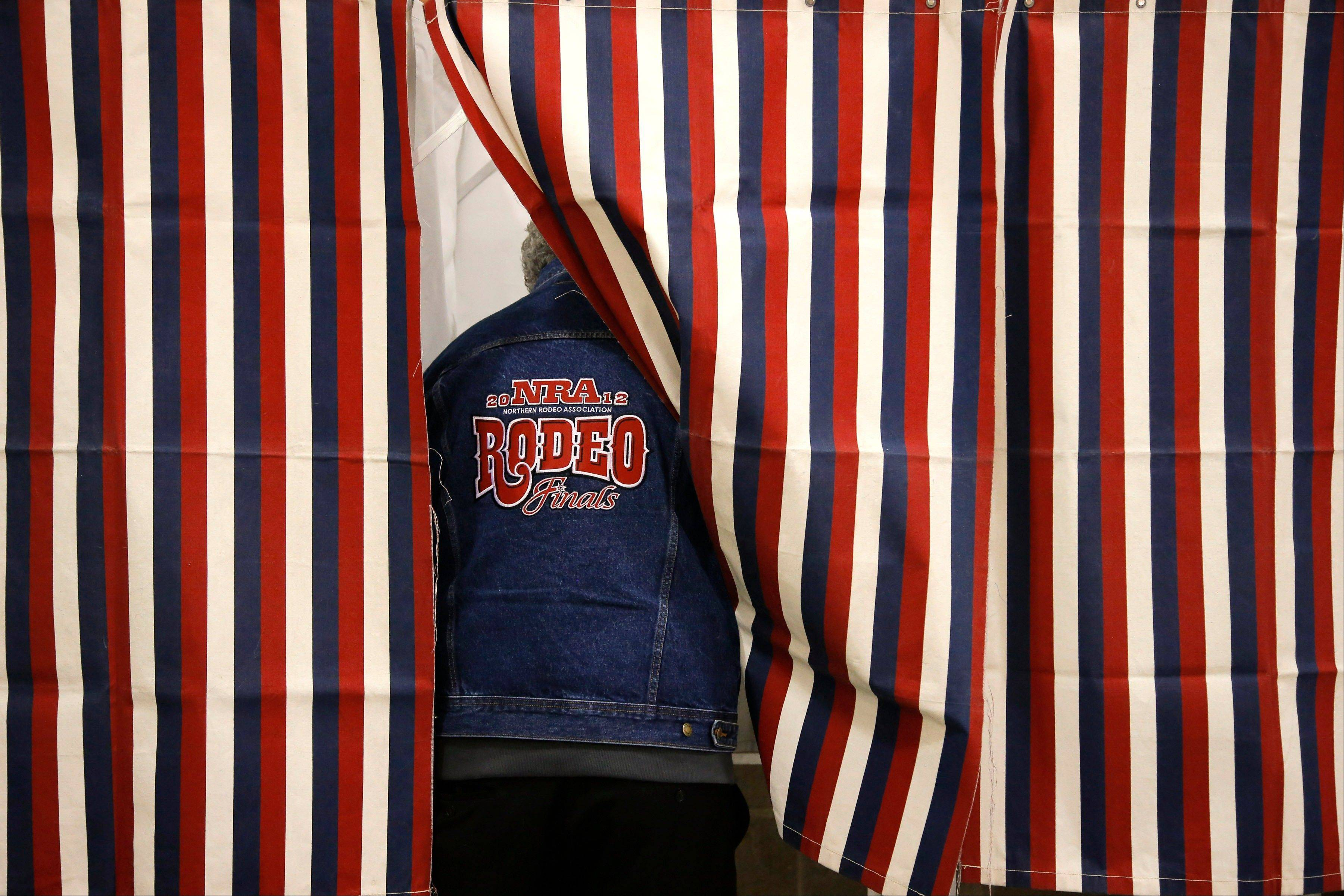 Rocky Erickson casts a ballot at a polling place on Election Day in Billings, Mont., Tuesday, Nov. 6, 2012.