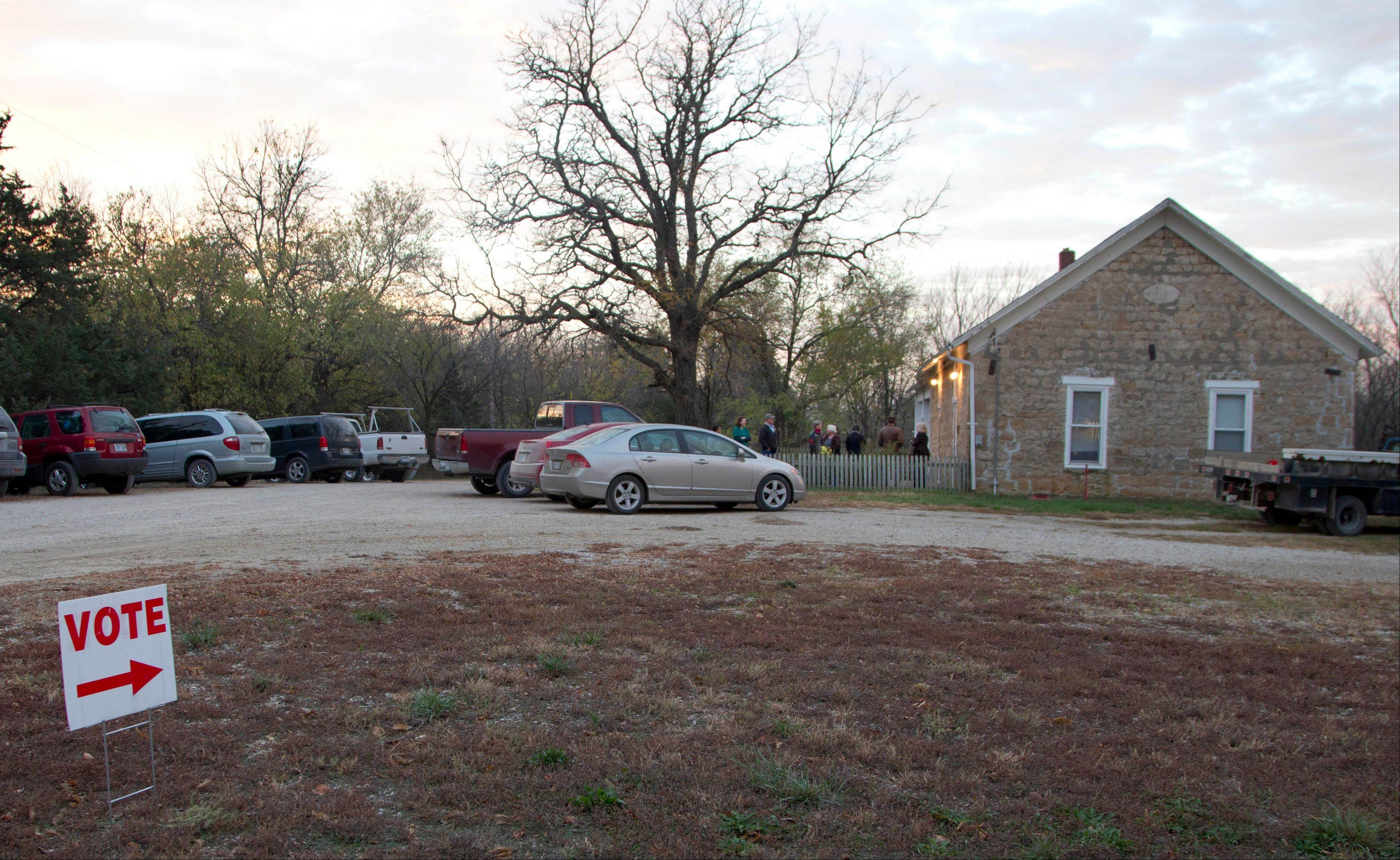 A line of voters extends outside Clinton Town Hall in Clinton, Kan., Tuesday, Nov. 6, 2012.