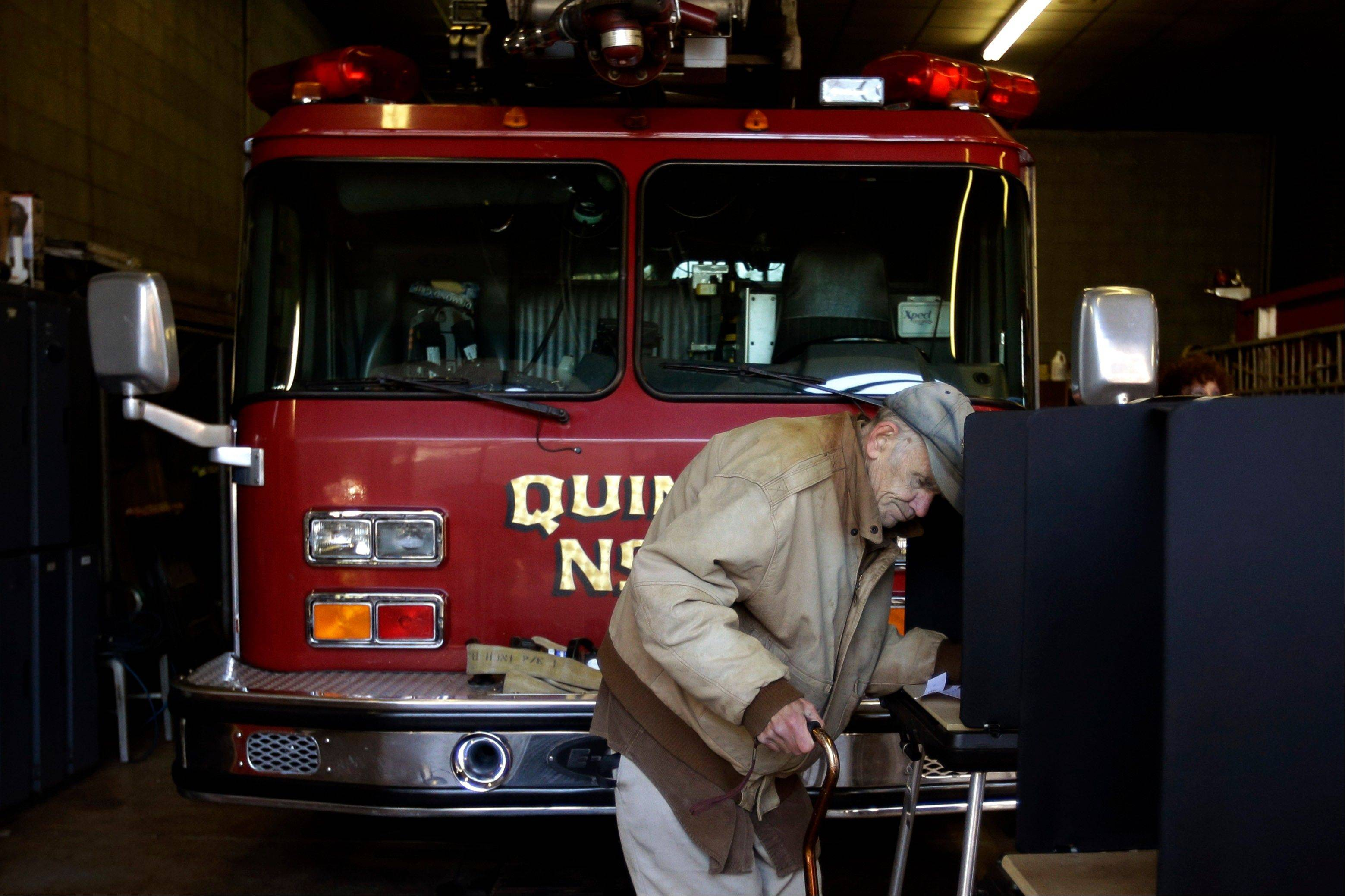 Edward Horan, of Scranton, Pa., casts his vote at a polling place inside a fire station, Tuesday, Nov. 6, 2012, in Scranton, Pa.