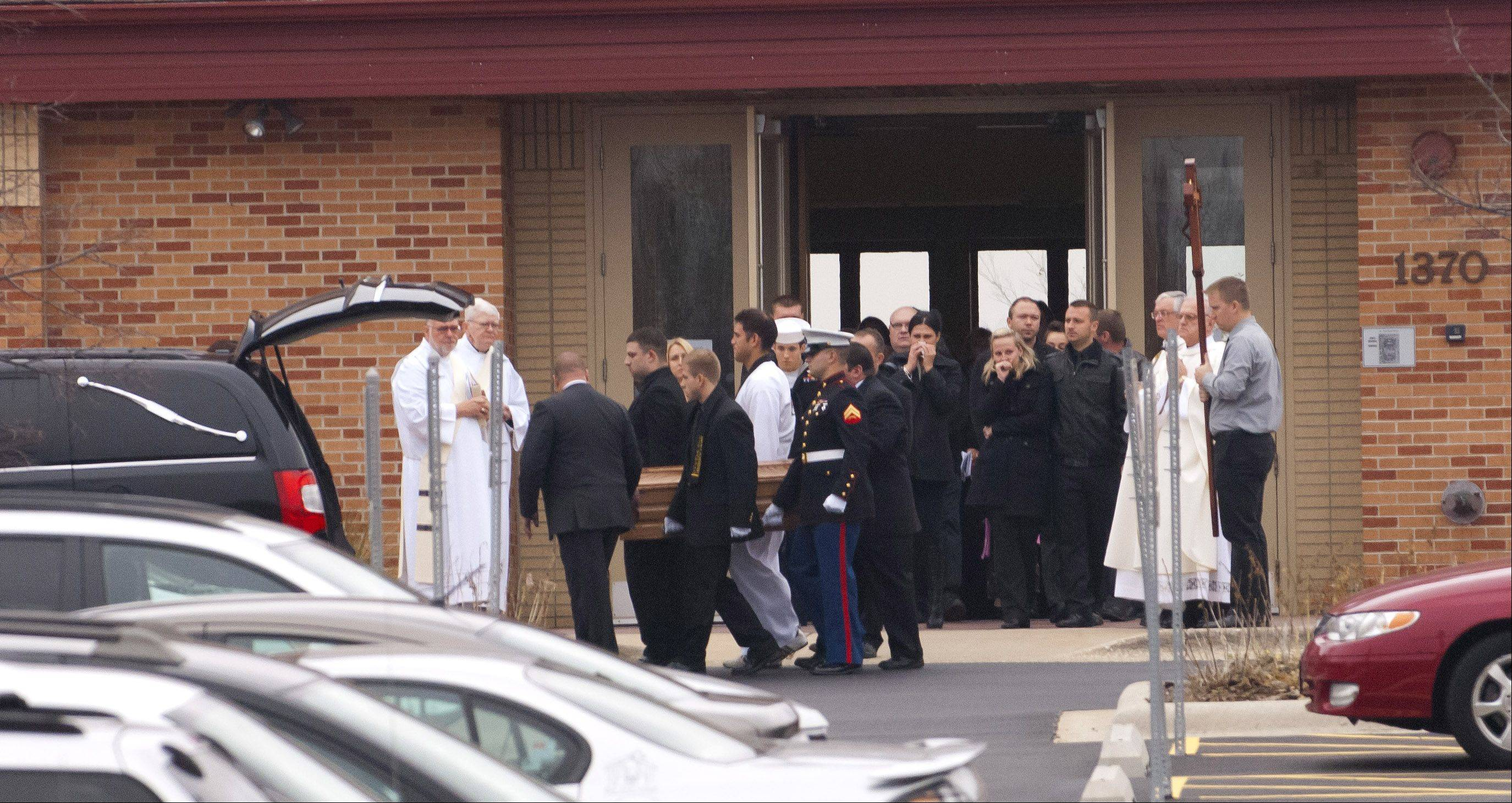 Mourners paid their final respects to 7-year-old Justin Plackowski Tuesday morning at St. Elizabeth Seton Catholic Church in Naperville.