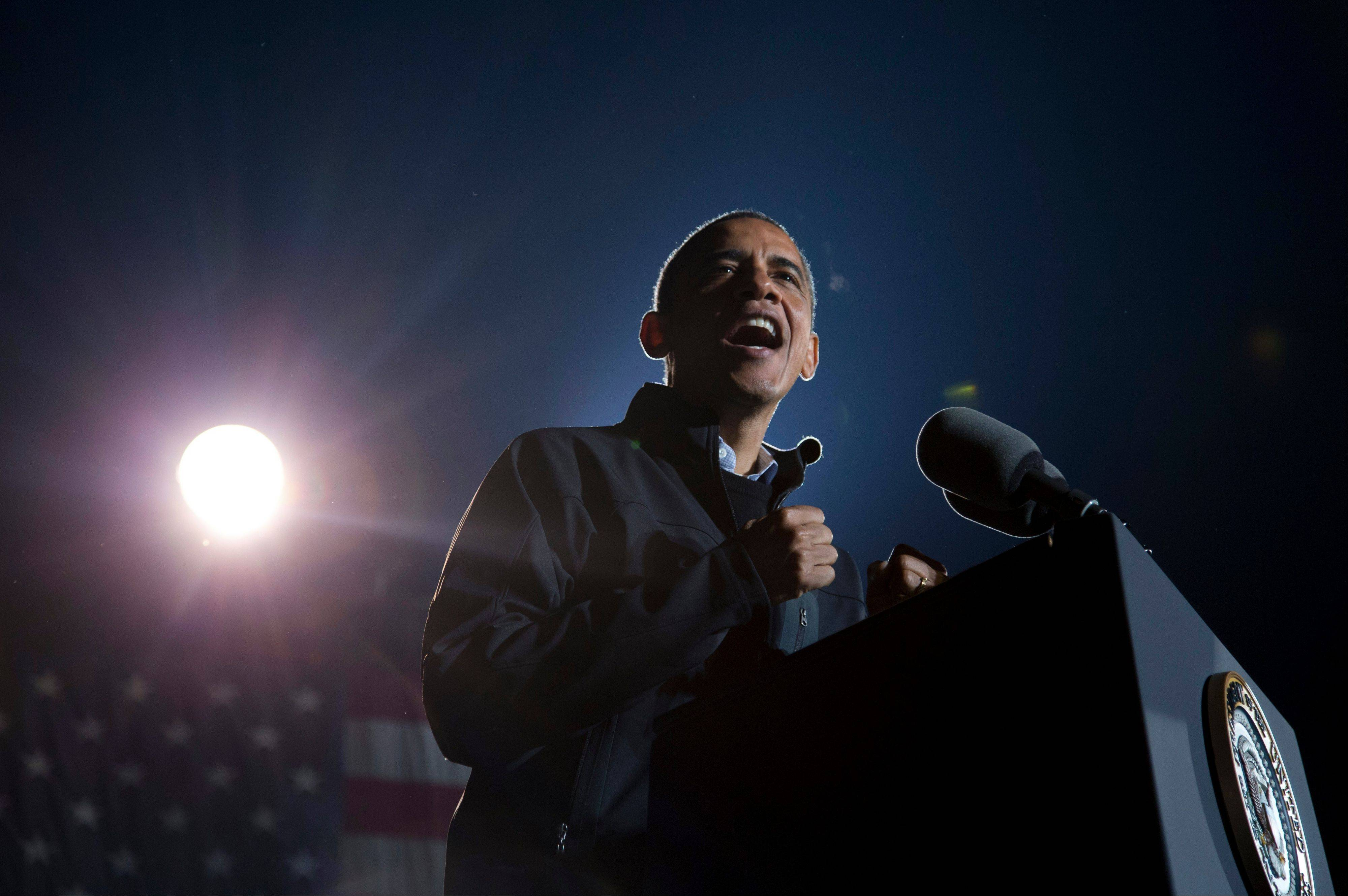 President Barack Obama gestures as he speaks at his final campaign stop on the evening before the 2012 election, Monday, Nov. 5, 2012, in Des Moines, Iowa.