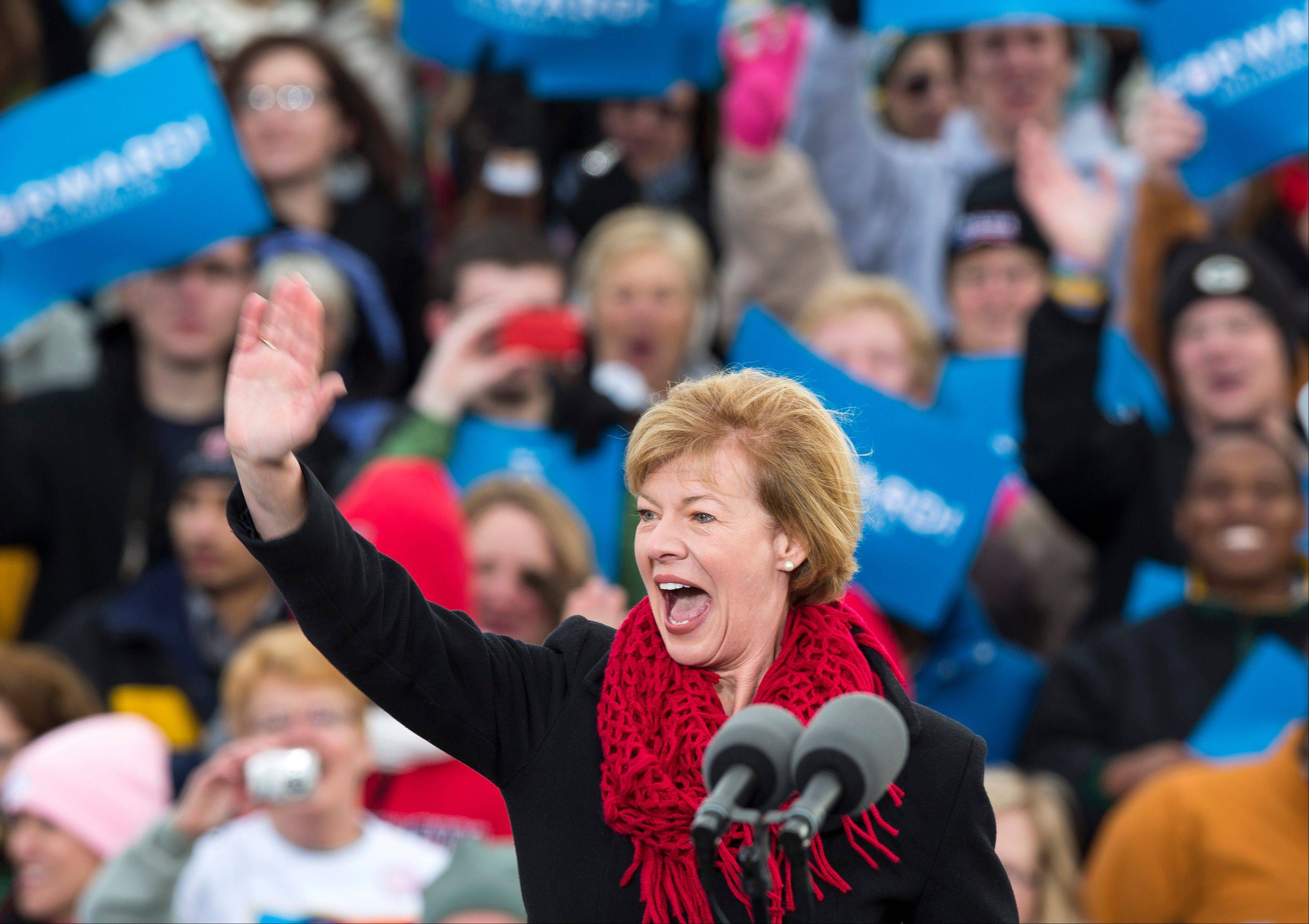 Wisconsin Republican Senate candidate, Rep. Tammy Baldwin, D-Wis., waves to the crowd before a campaign stop by President Barack Obama at Austin Straubel International Airport in Green Bay, Wis.