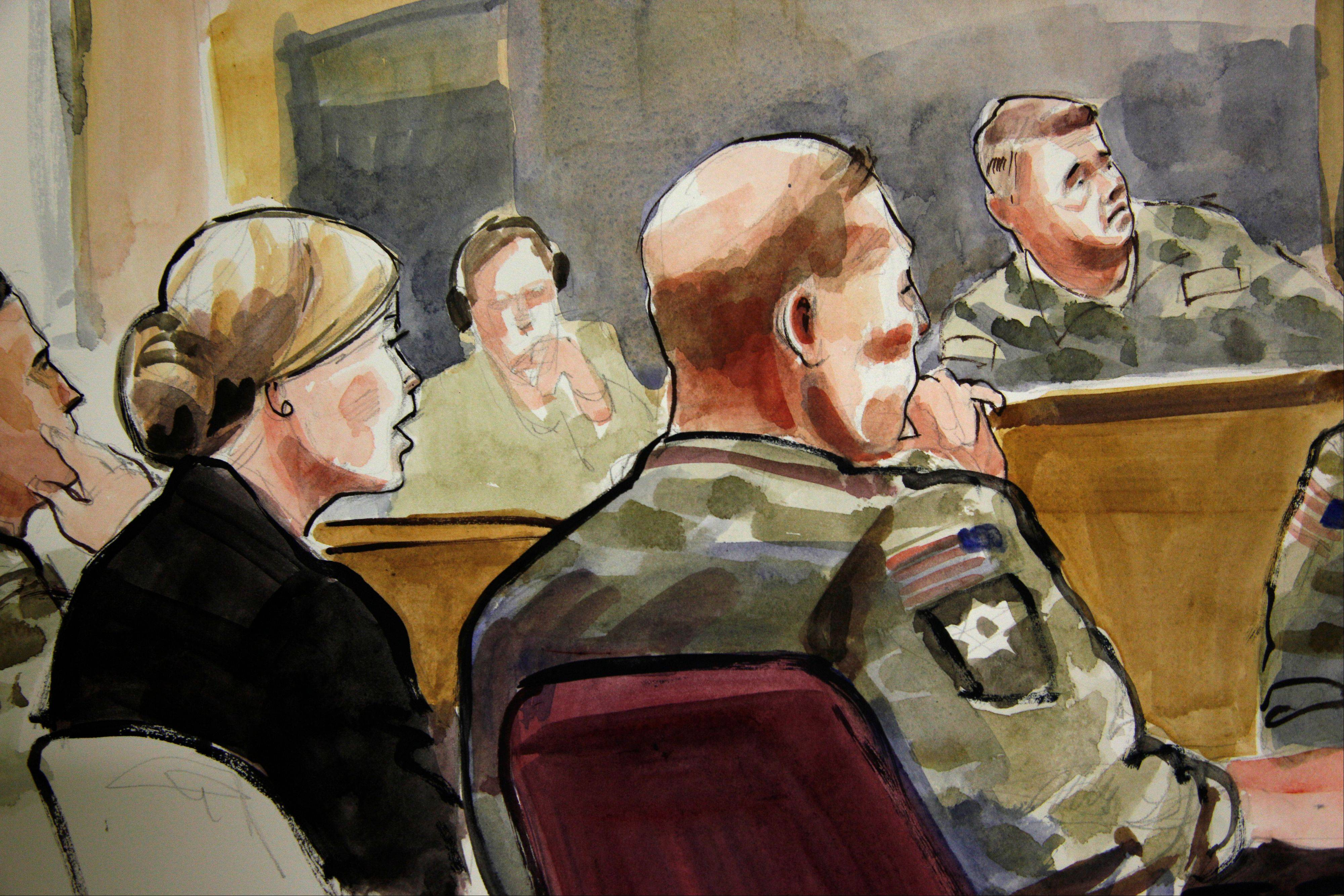 In this detail of a courtroom sketch, U.S. Army Staff Sgt. Robert Bales, seated at front-right, listens Monday, Nov. 5, 2012, during a preliminary hearing in a military courtroom at Joint Base Lewis McChord in Washington state. Bales is accused of 16 counts of premeditated murder and six counts of attempted murder for a pre-dawn attack on two villages in Kandahar province in Afghanistan in March, 2012. At upper-right is Investigating Officer Col. Lee Deneke, and seated at front-left is Bales' civilian attorney, Emma Scanlan.