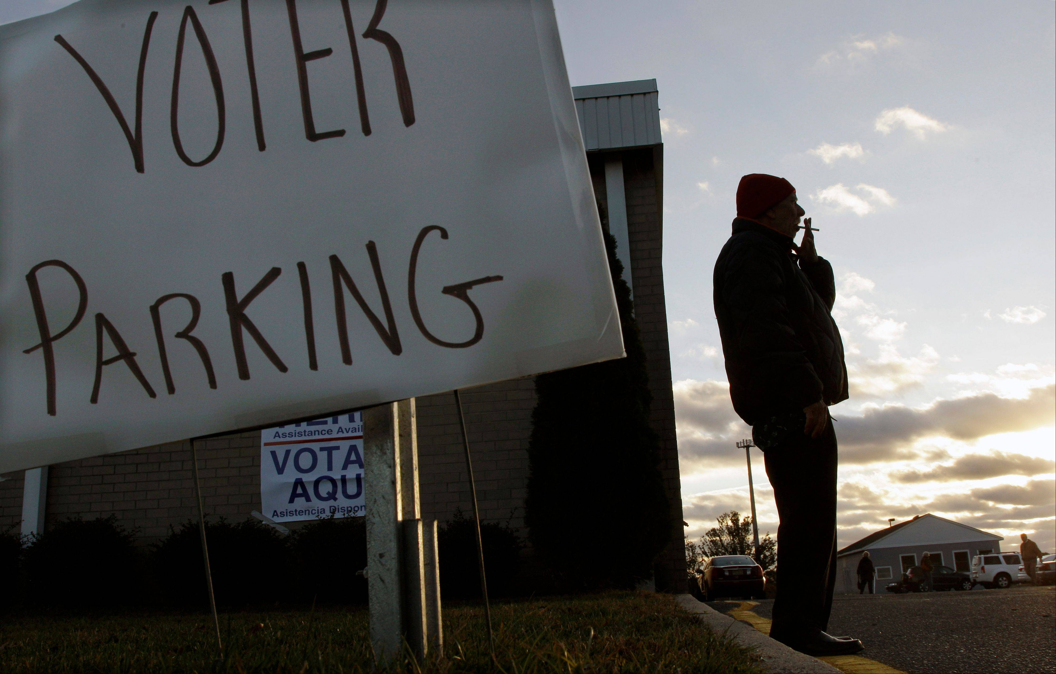 Don Dunkelburger, of Seaside Heights, N.J., takes a smoke break outside a shelter and polling station at Toms River East High School Tuesday, Nov. 6, 2012. Dunkelburger, who lost his home and was staying in the shelter, said he was not clear on where he was supposed to vote Tuesday.