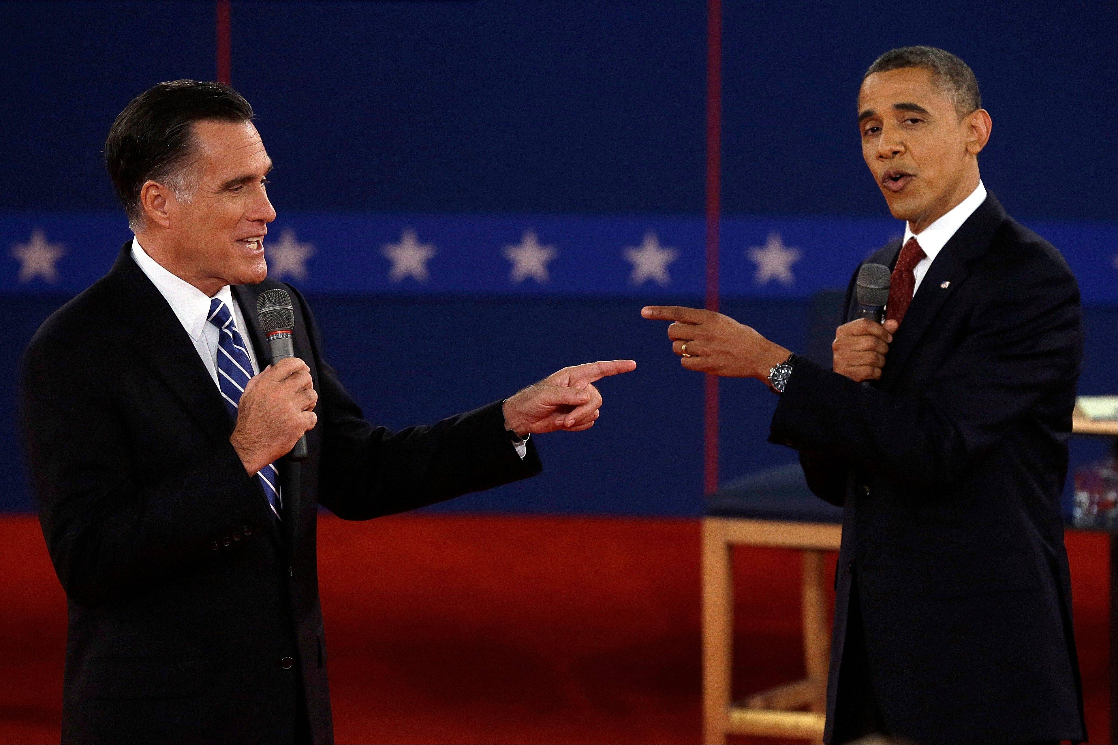 In this Oct. 16 file photo, Republican presidential candidate, former Massachusetts Gov. Mitt Romney and President Barack Obama spar during the second presidential debate at Hofstra University in Hempstead, N.Y.