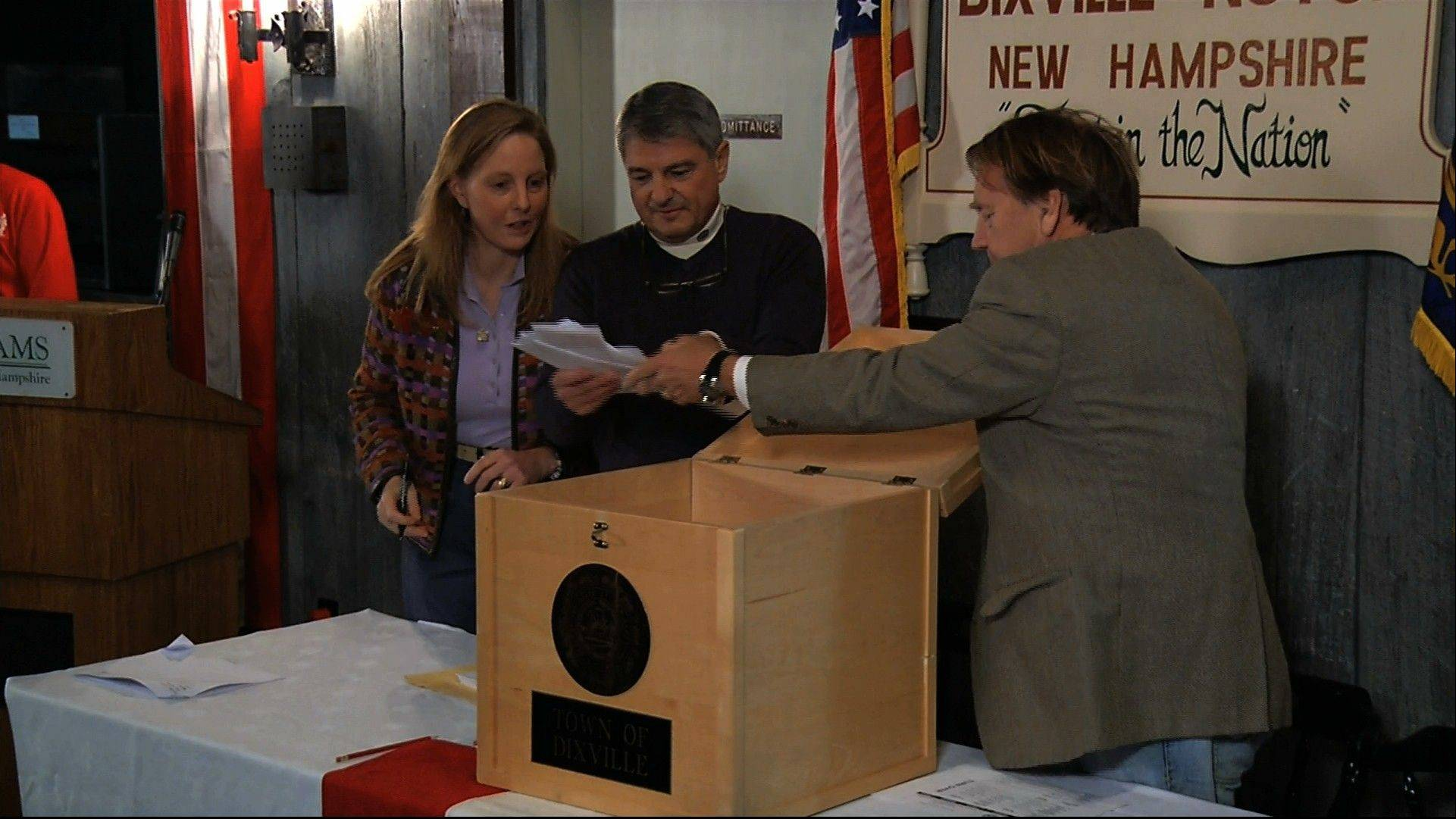 In this still frame made from video, ballots are removed from the ballot box to be counted in Dixville Notch, N.H., Tuesday, as they cast the first Election Day votes in the nation.
