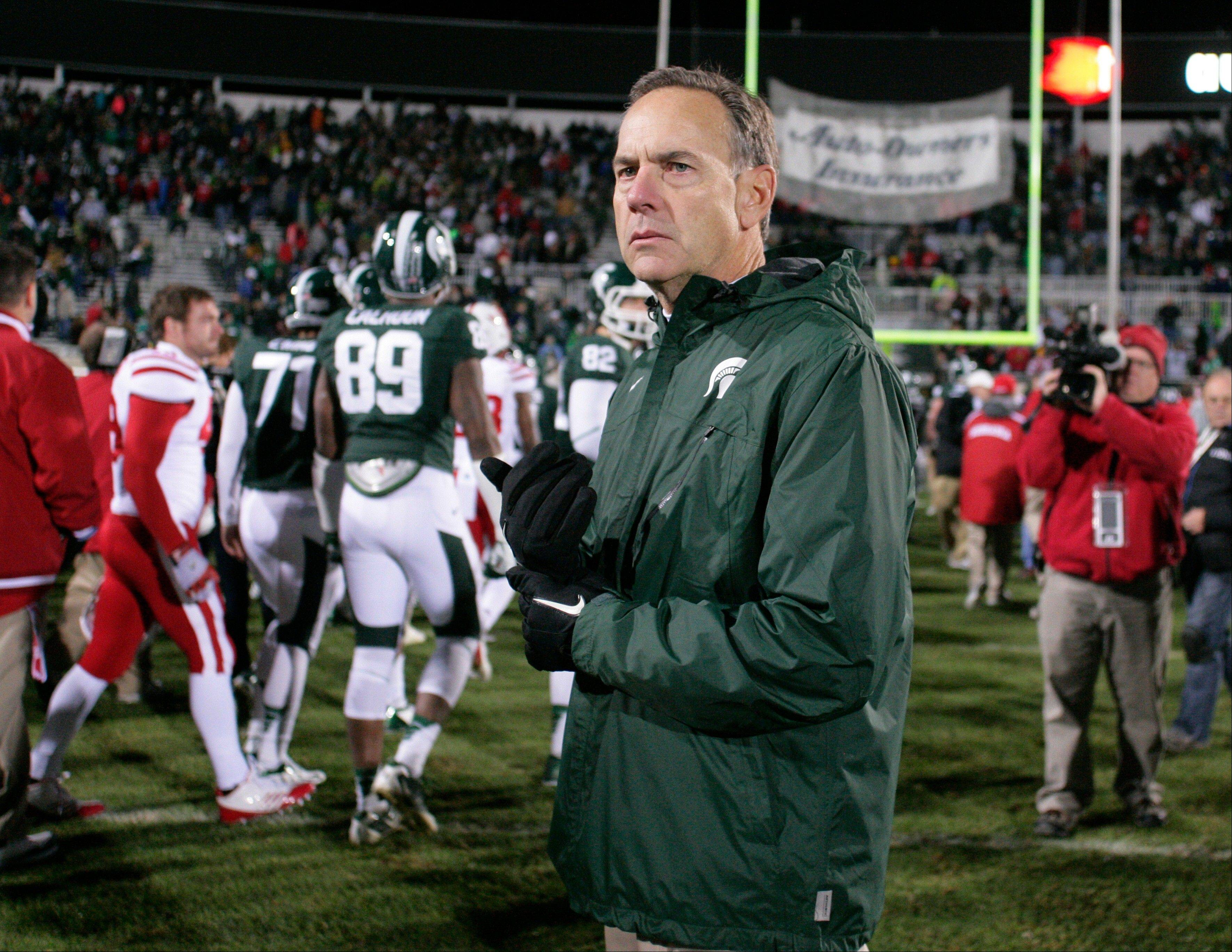 Michigan State coach Mark Dantonio pauses on the field Saturday following a 28-24 loss to Nebraska in East Lansing, Mich.