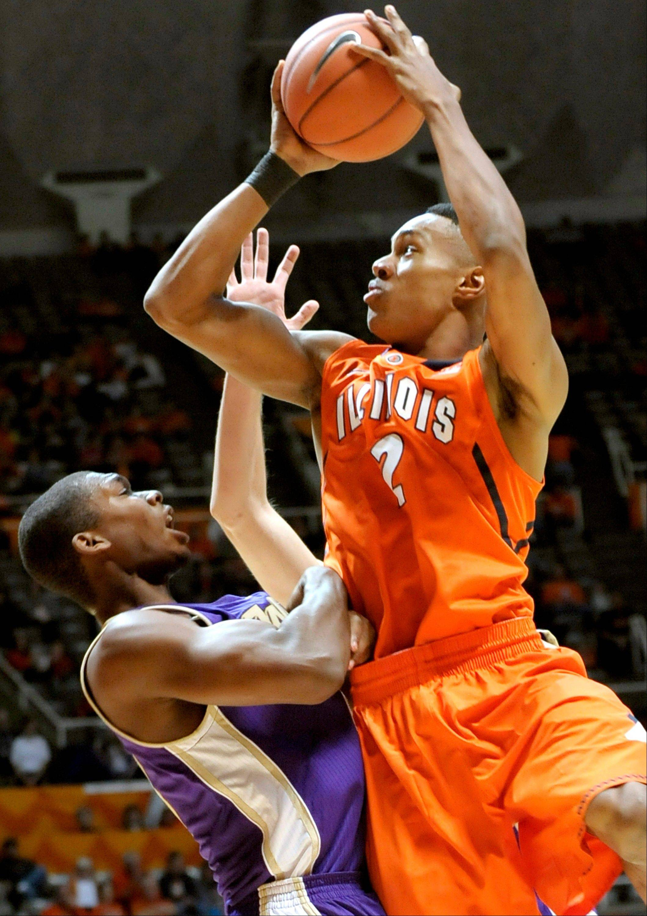 Illinois' Joseph Bertrand drives against West Chester's Corey Blake during their exhibition game Sunday in Champaign.