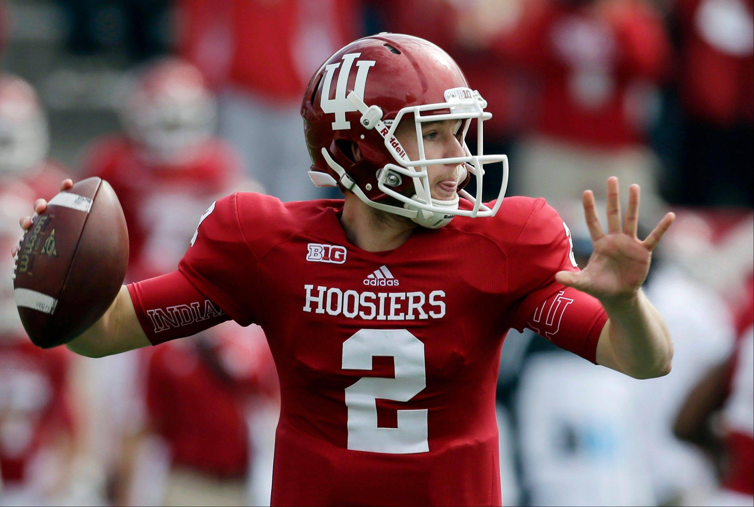 Indiana quarterback Cameron Coffman throws against Michigan State in Bloomington, Ind. Coffman's father, Paul, was an All-Pro tight end with the Green Bay Packers in the 1980s. Indiana hosts Wisconsin on Saturday.