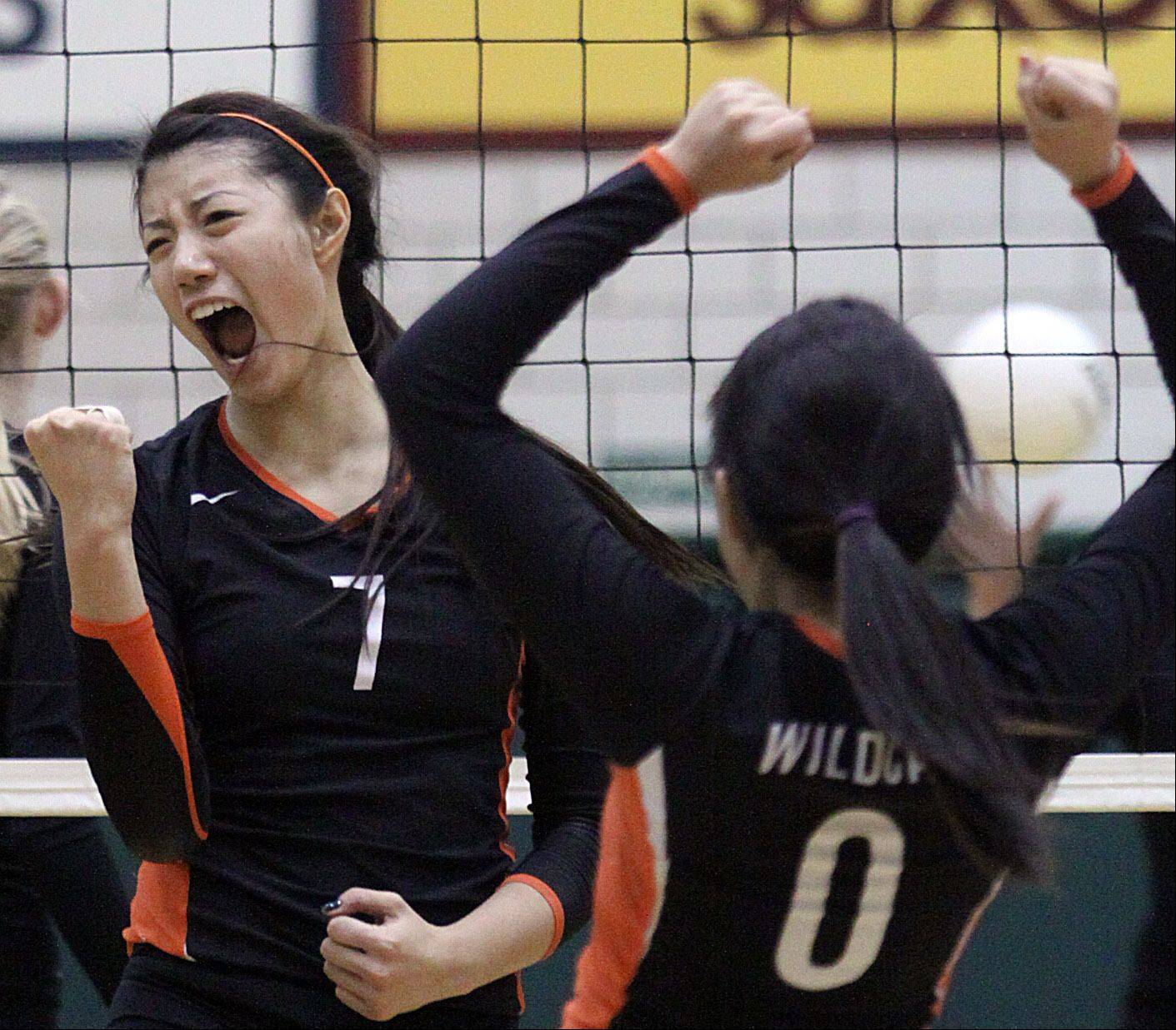 Libertyville's Cindy Zhou, left, screams with delight as she celebrates with teammate Vicky Liu during Thursday's sectional title volleyball game win over Palatine.