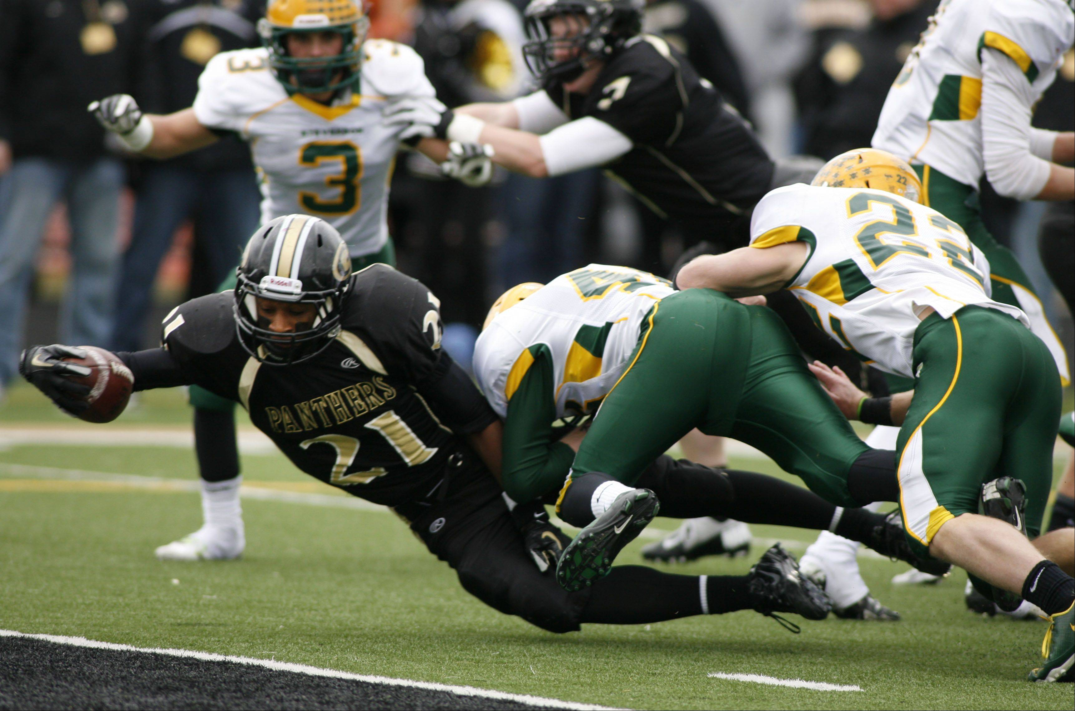 Glenbard North's Justin Jackson extends for a touchdown against Stevenson Saturday.