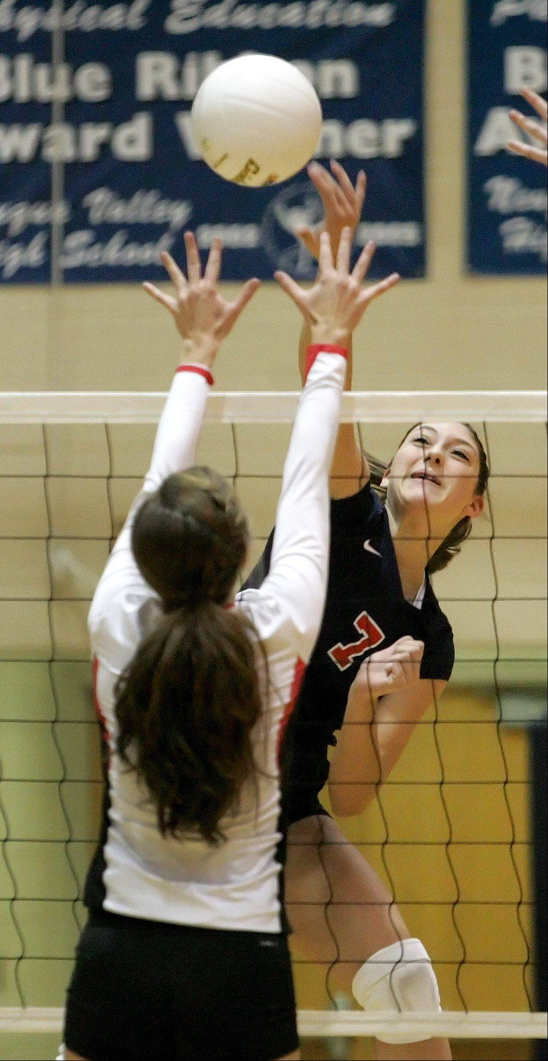 Lauren Carlini of West Aurora tips the ball in action against Benet Tuesday.