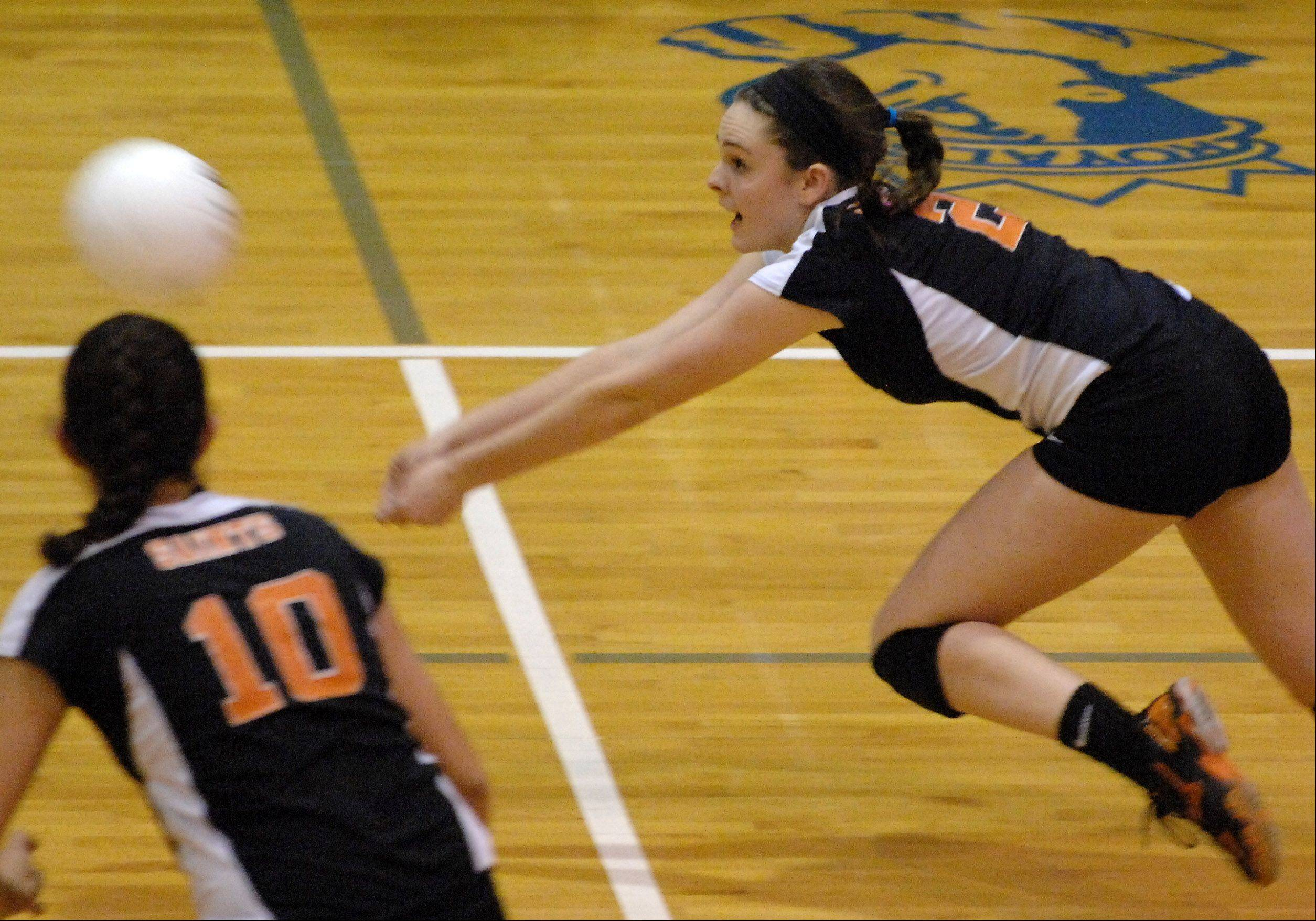 St. Charles East's Katie Kull lunges for the ball during Tuesday's sectional semifinals at Larkin High School in Elgin.