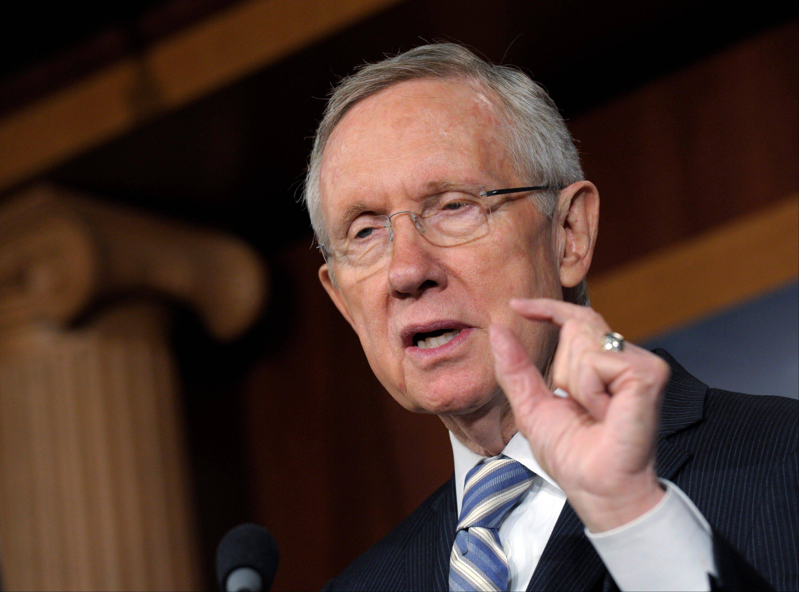 Senate Majority Leader Harry Reid, a Nevada Democrat, gestures Wednesday as he discusses Tuesday�s election results during a news conference on Capitol Hill in Washington.