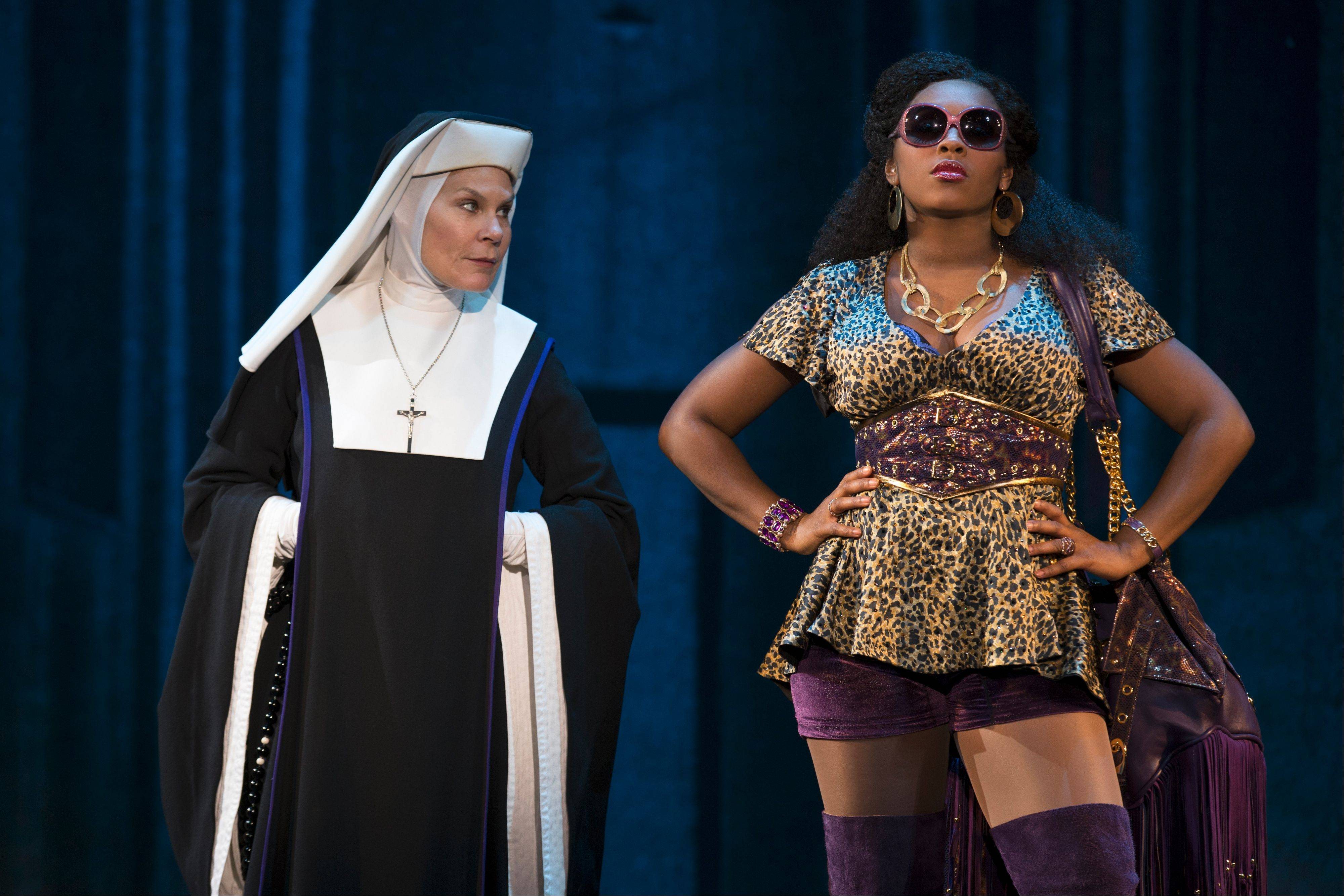 "Mother Superior (Chicago actress Hollis Resnik) doesn't see eye-to-eye with in-hiding disco singer Deloris Van Cartier (Ta'Rea Campbell) in the national tour of the 2011 Broadway musical ""Sister Act."""