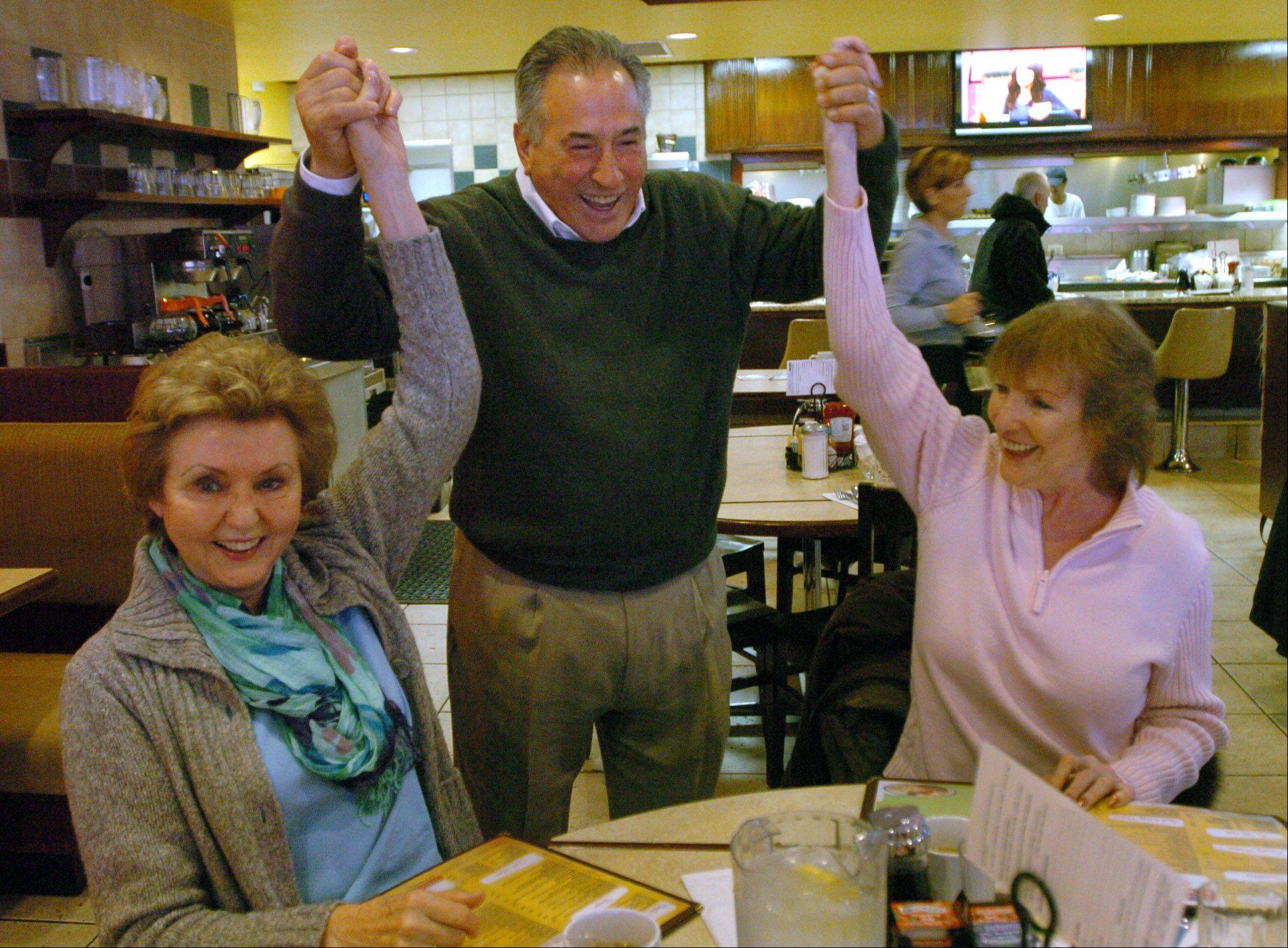 Des Plaines Mayor Marty Moylan thanks Mary Pat Monteleone, left, and Kathleen Fergus for their support, while visiting with patrons at the Sugar Bowl restaurant after winning the 55th State House District race in Tuesday's election.