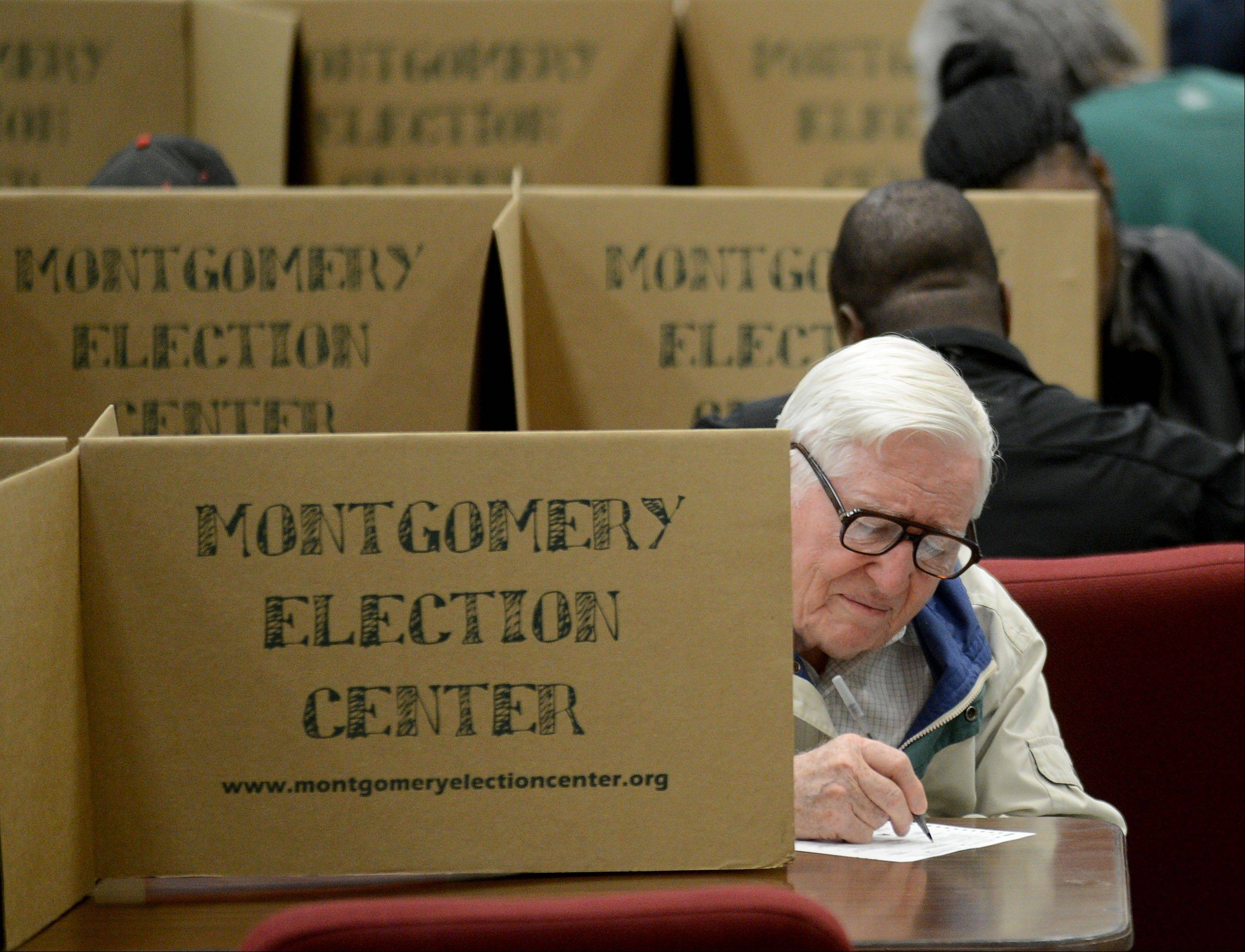 Mervel Parker fills out his ballot to vote in the election at Aldersgate United Methodist Church in Montgomery, Ala., Tuesday, Nov. 6, 2012.