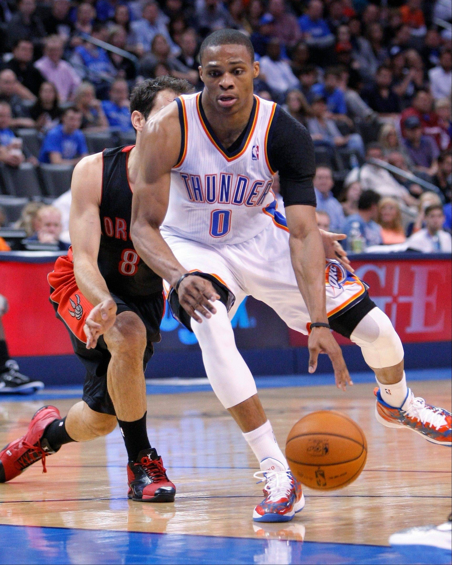 Oklahoma City Thunder guard Russell Westbrook (0) drives to the basket in front of Toronto Raptors guard Jose Calderon during the third quarter of an NBA basketball game in Oklahoma City, Tuesday, Nov. 6, 2012. Oklahoma City won 108-88. (AP Photo/Alonzo Adams)