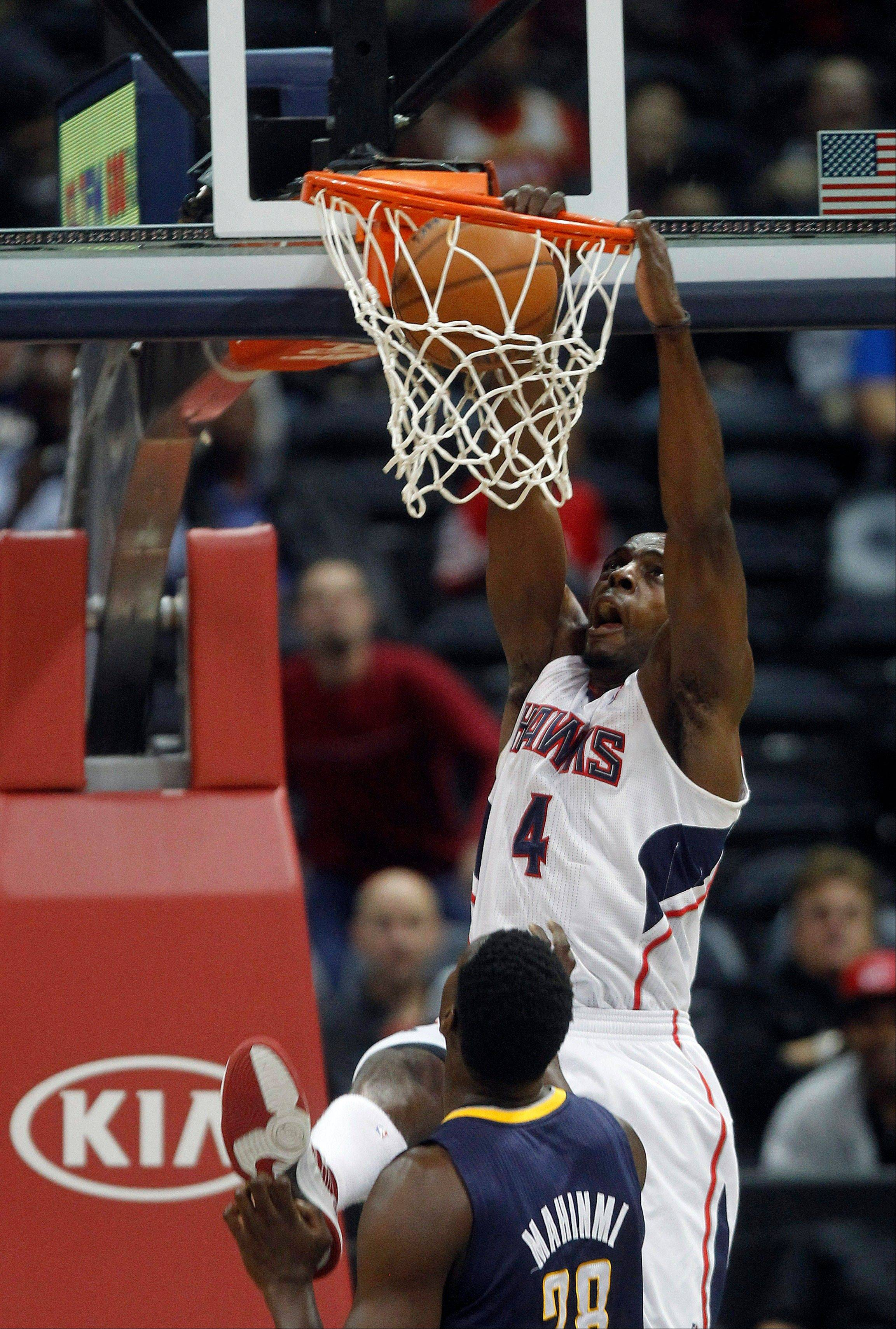Atlanta Hawks power forward Anthony Tolliver scores as Indiana Pacers center Ian Mahinmi defends Wednesday in the first half in Atlanta.
