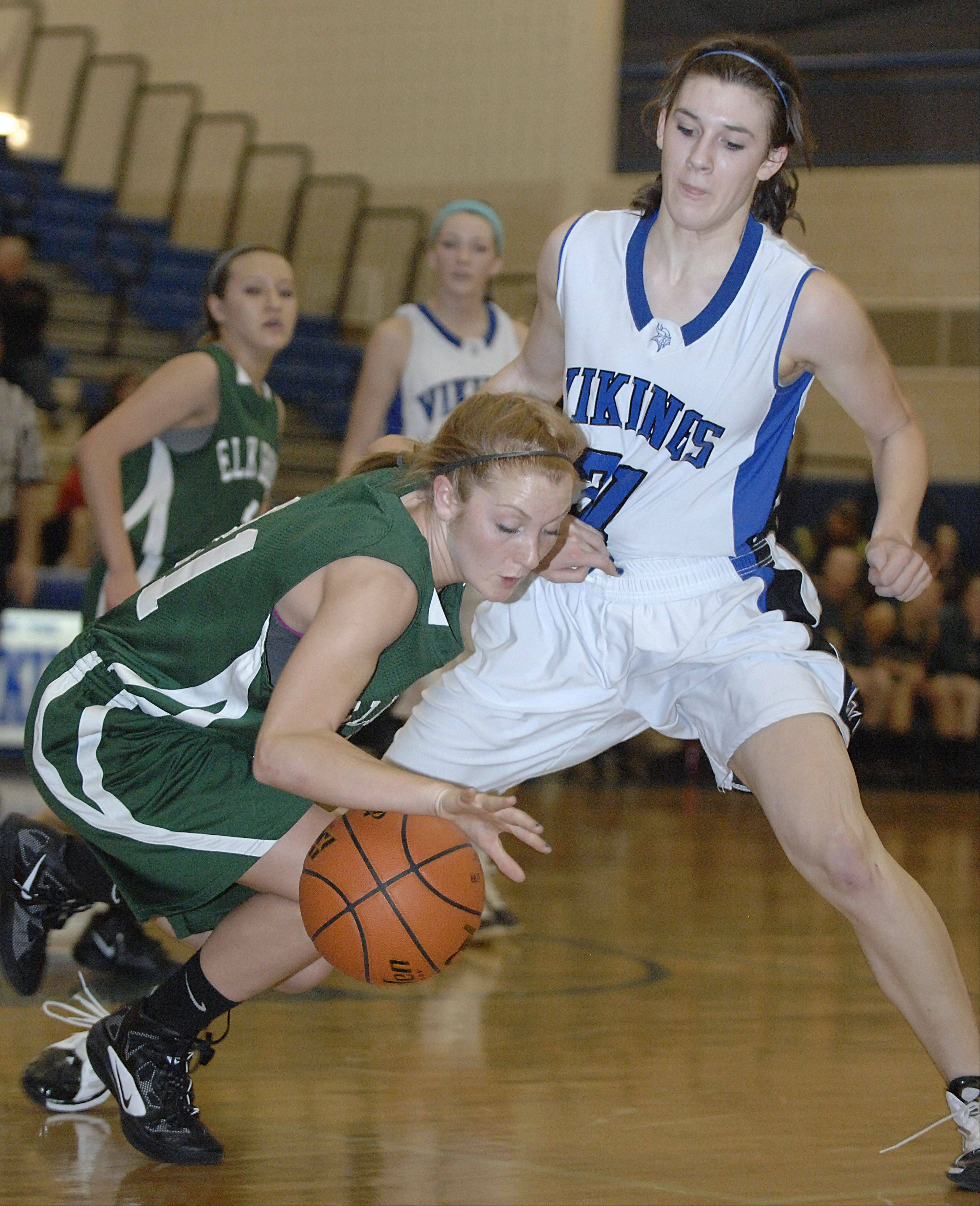 Elk Grove's Kelly Naughton keeps her dibble alive despite pressure from Geneva's Sami Pawlak last season in regional championship game action.