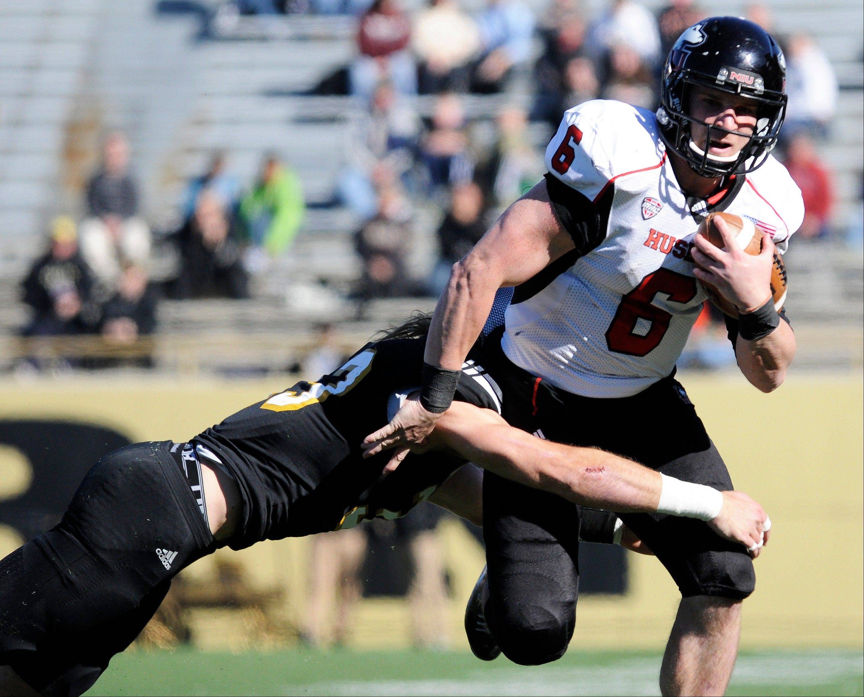 Western Michigan free safety Justin Currie brings down Northern Illinois quarterback Jordan Lynch during the first half of an NCAA college football game Saturday, Oct. 27, 2012, in Kalamazoo, Mich. (AP Photo/The Gazette, Matt Gade) LOCAL TV OUT LOCAL INTERNET OUT