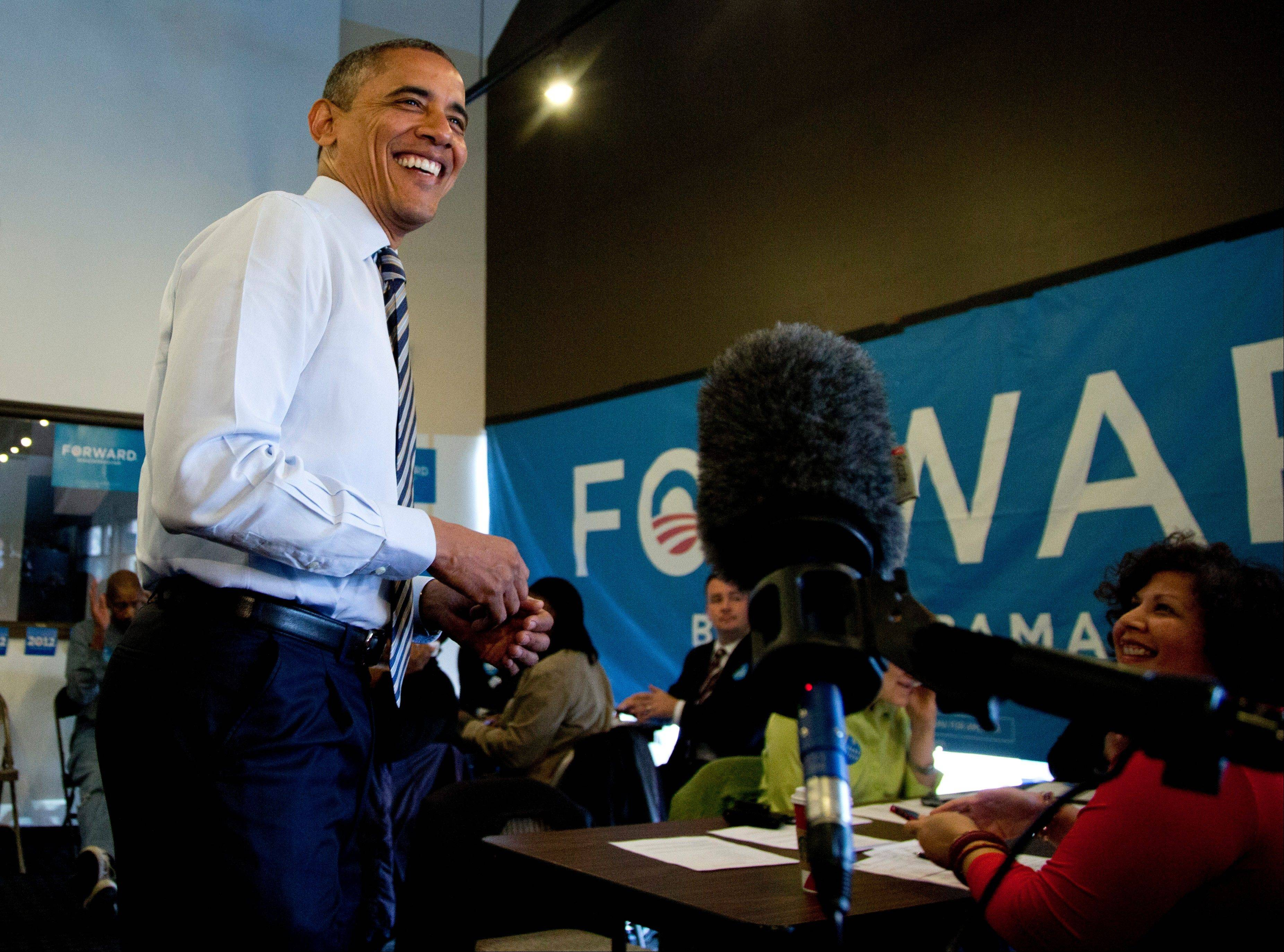 President Barack Obama speaks to media as he visits a campaign office the morning of the 2012 election, Tuesday, Nov. 6, 2012, in Chicago.