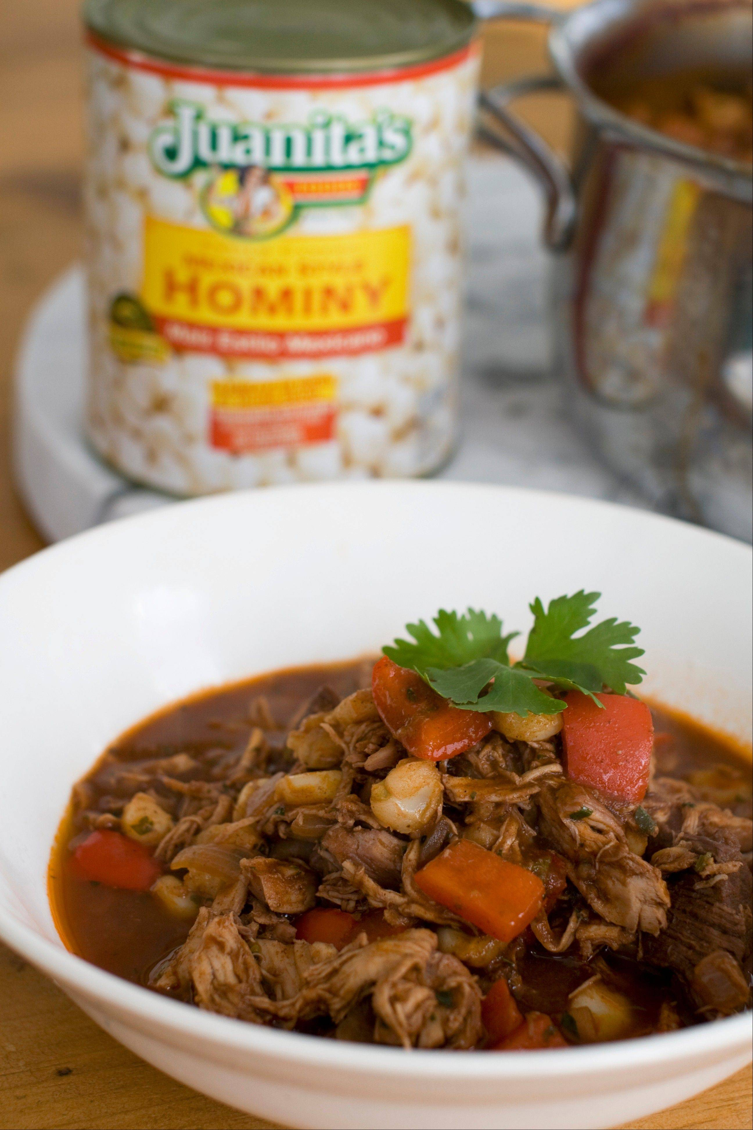 Hominy lends a fresh, tender corn flavor to a rich stew of pulled chicken and seared steak tips.