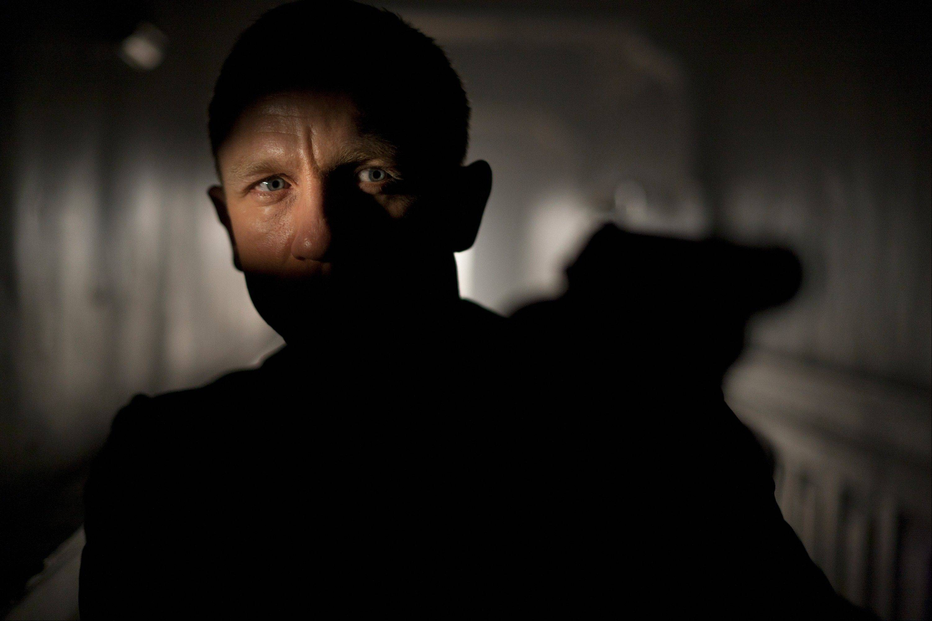 "James Bond (Daniel Craig) prepares for opposition in the 007 thriller ""Skyfall."""
