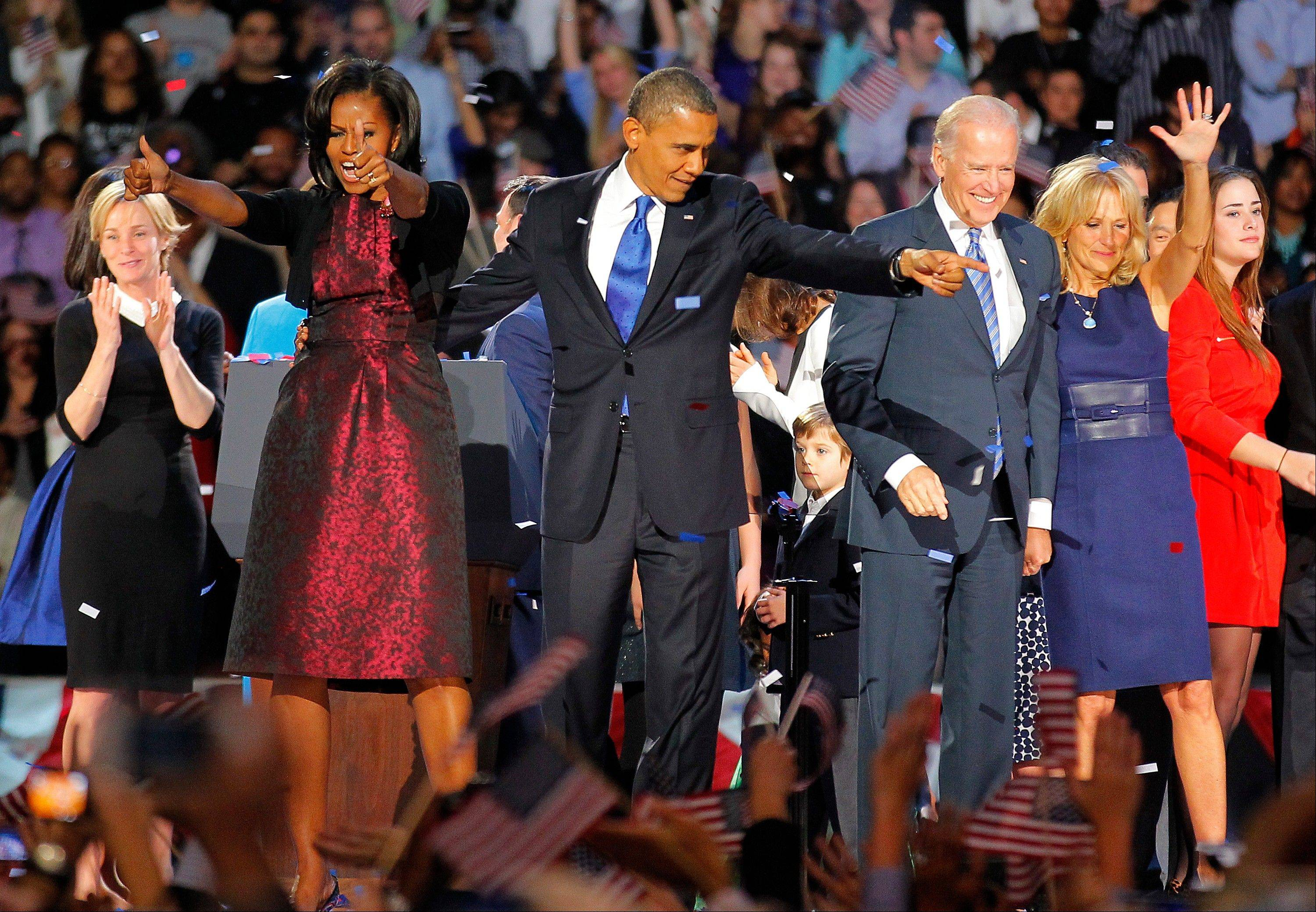 President Barack Obama, joined by his wife Michelle, Vice President Joe Biden and his spouse Jill acknowledge applause after Obama delivered his victory speech to supporters gathered in Chicago early Wednesday.