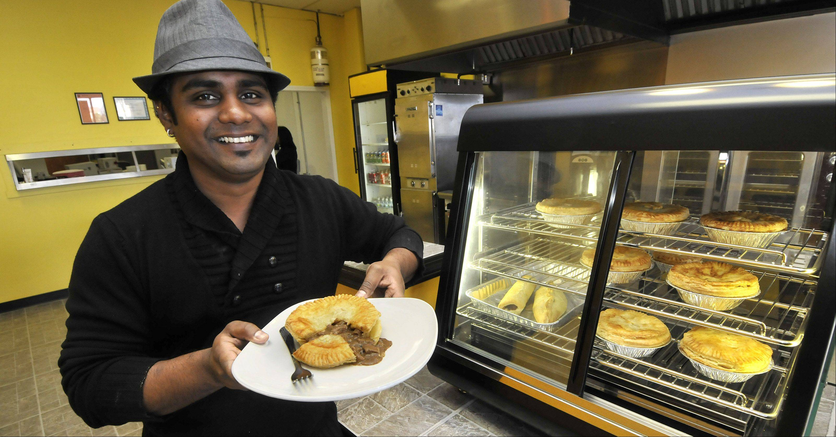 Owner Tyrel Naidoo shows off one of his steak pies in his Pie Boss shop in Aurora. He bakes a variety of pies filled with beef, chicken, spinach and feta cheese. You can order them to-go or take home frozen pies to enjoy later.