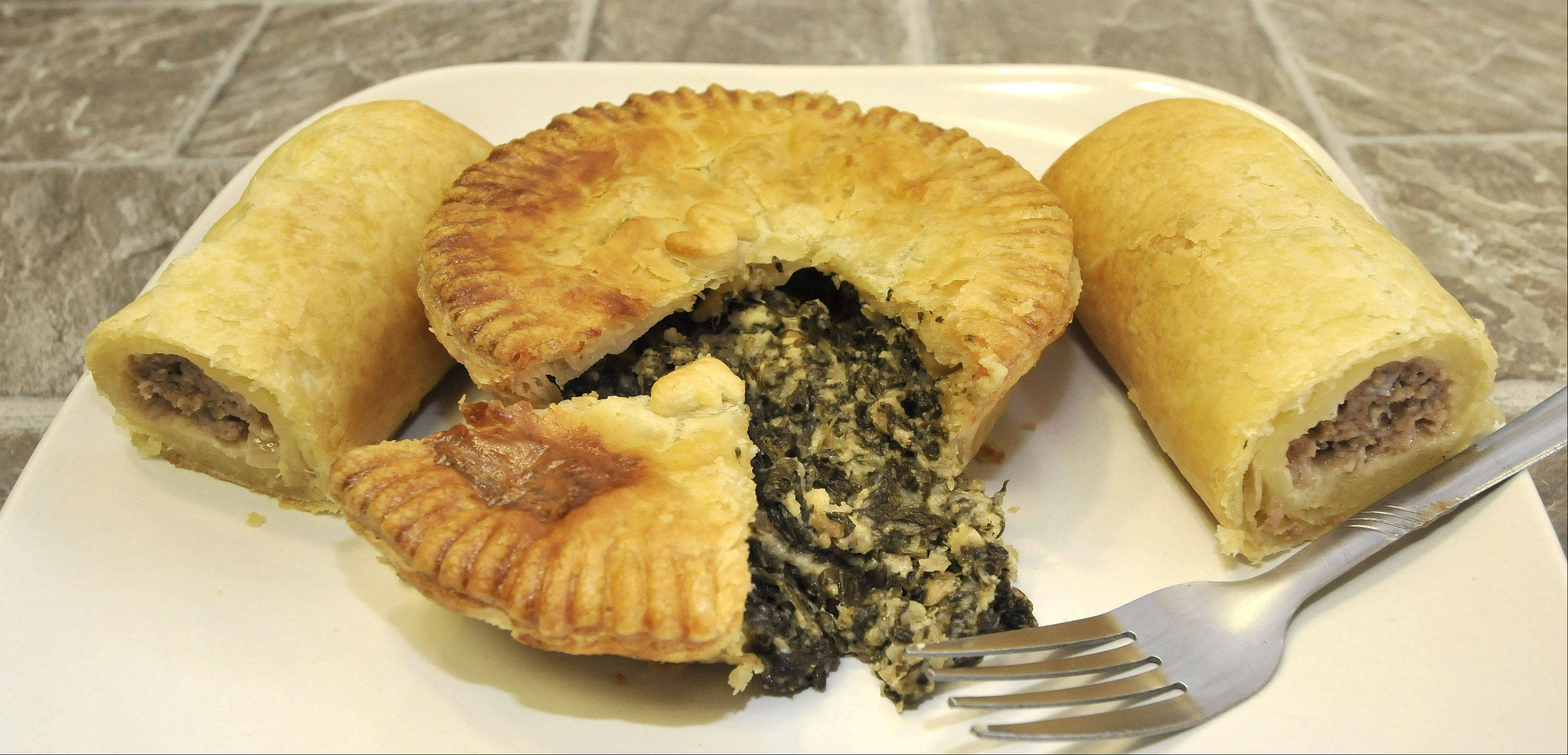 Spinach- and feta-stuffed savory pies and sausage rolls are on the menu at Pie Boss in Aurora.