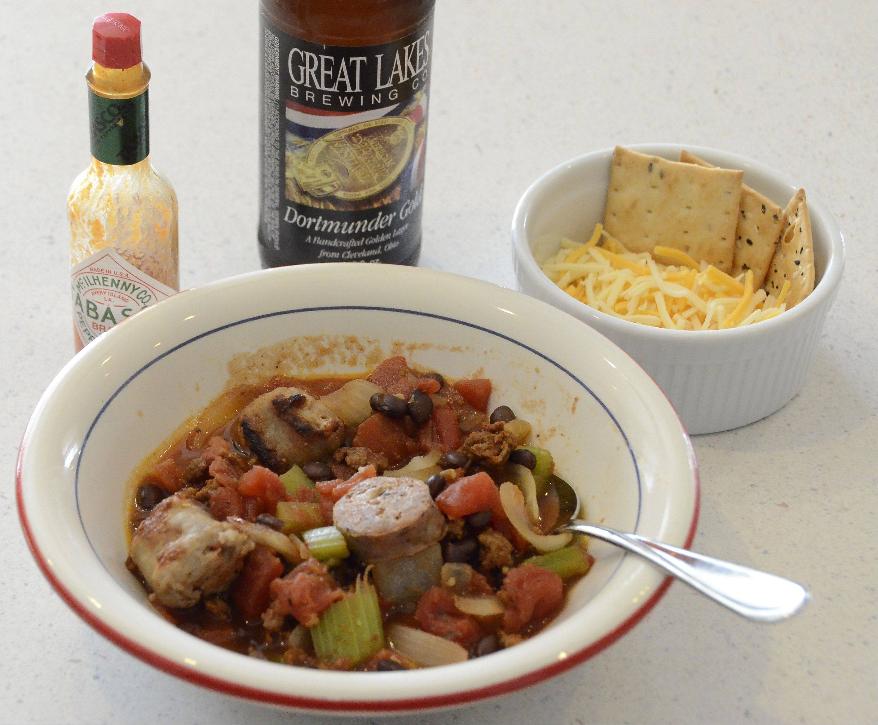 Sausage aficionado Kent Kleiva of Palatine uses three varities of sausage in his chili.