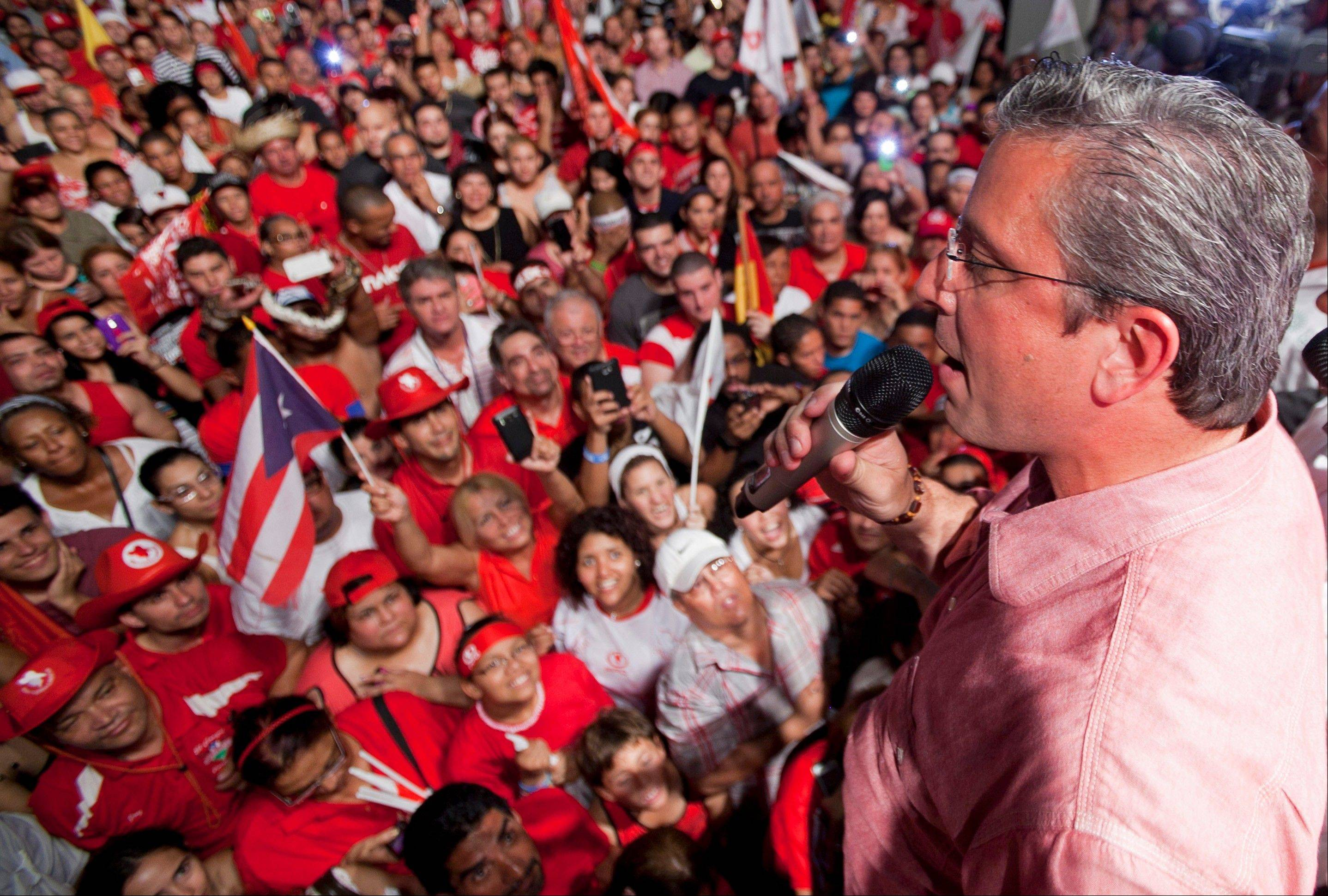 Alejandro Garcia Padilla, candidate for governor of Puerto Rico, of the pro-commonwealth Popular Democratic Party, speaks to supporters in San Juan, Puerto Rico, Wednesday. Incumbent Gov. Luis Fortuno conceded defeat to Garcia Padilla in a close election with a margin less than 1 percent.