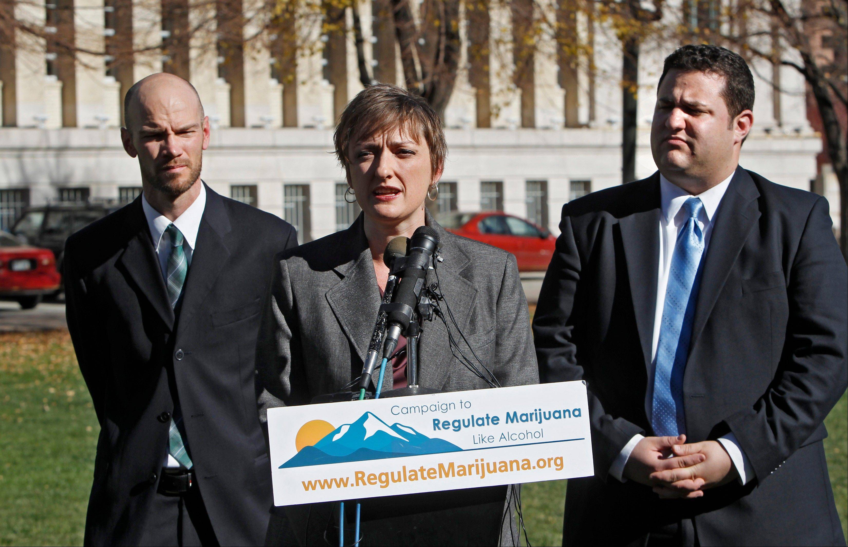 Betty Aldworth, center, a director of the Yes on 64 campaign responds to questions about the legalization of marijuana at a news conference in Denver on Wednesday. Co-directors Brian Vicente, left, and Mason Tvert, right, listen. Colorado voters passed Amendment 64 on Tuesday legalizing marijuana in Colorado for recreational use.