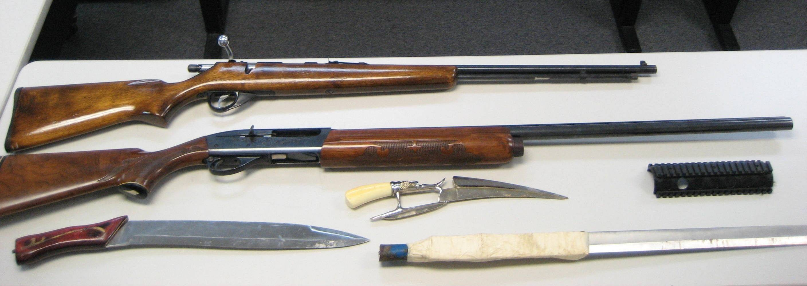 These weapons, including a homemade sword, were seized Tuesday evening by Round Lake Park police and the Department of Homeland Security as part of a joint investigation targeting suspected street gang members in the area.