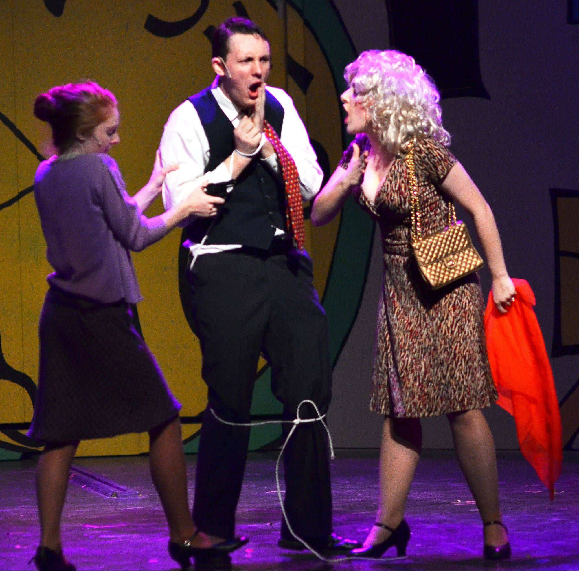 "In a rehearsal for Batavia High School's production of ""9 to 5: the Musical,"" Judy Bernly and Doralee Rhodes give their boss, Mr. Franklin Hart, a hard time."