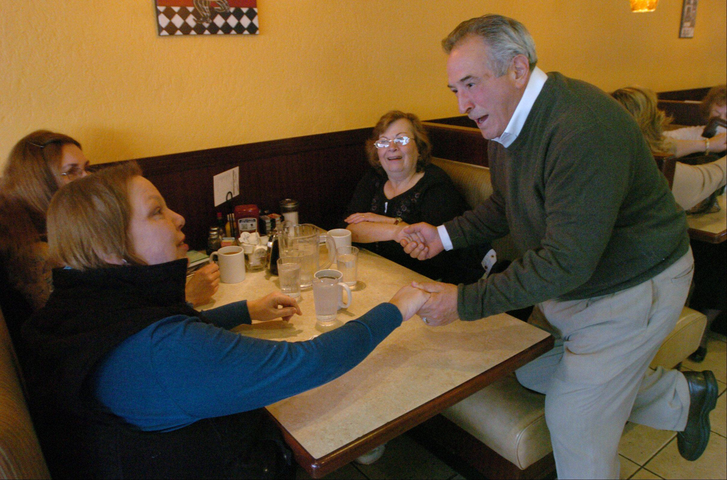 Des Plaines Mayor Marty Moylan visits with, from left, Pat Orlow, Leslie Menarik and Marie Grasser, thanking patrons of the Sugar Bowl restaurant for voting for him to represent the 55th State House District.