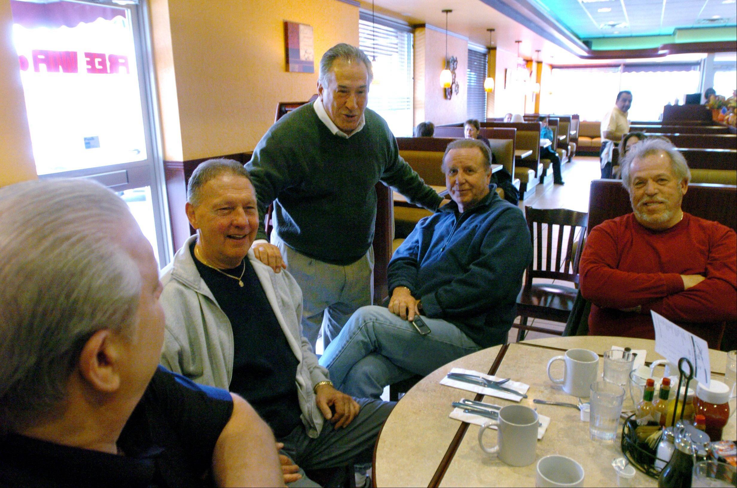 Des Plaines Mayor Marty Moylan thanks, from left, Bill Schaefer, Charlie Molnar, George Ruckrich and Bill Hanhardt for their support while visiting with patrons at the Sugar Bowl restaurant after securing the 55th State House District seat Tuesday.