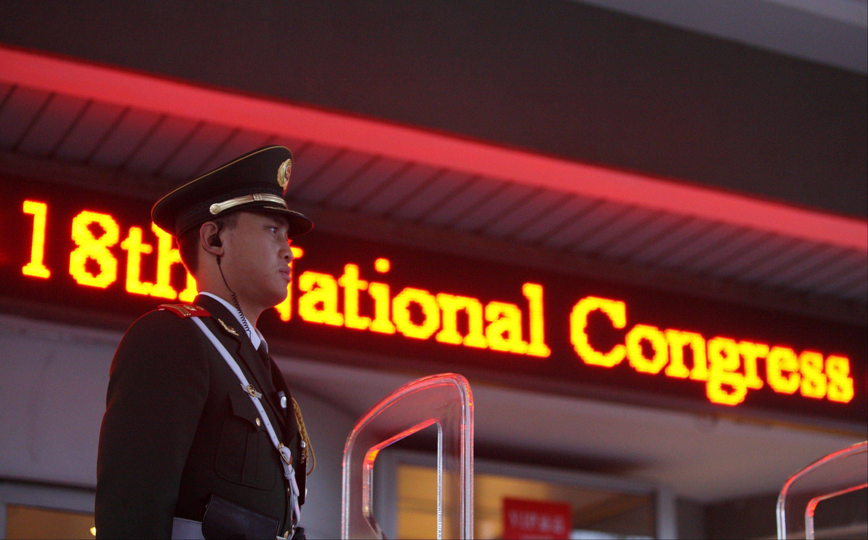 A security guard stands outside the media center for the 18th National Congress of the Communist Party of China in Beijing, China, on Wednesday, Nov. 7, 2012. China's Vice President Xi Jinping was appointed the secretary general of the 18th Chinese Communist Party Congress, spokesman Cai Mingzhao said at a briefing today.