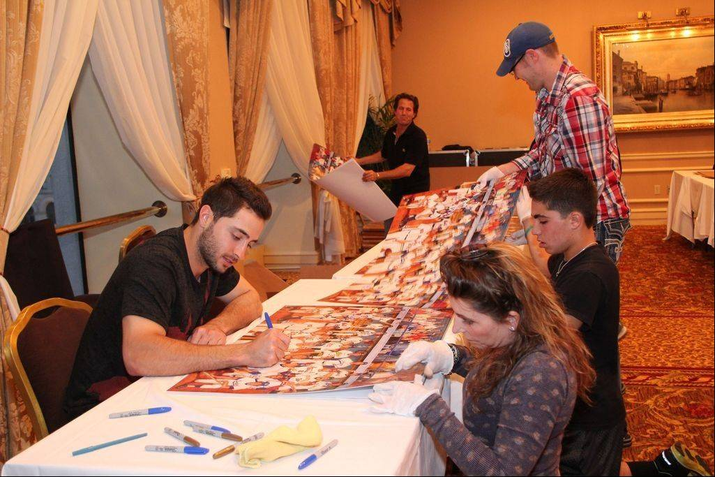 Milwaukee Brewers player Ryan Braun, 2011 MVP, autographs lithographs that commemorate the role of Jews in Major League Baseball. The lithographs were created through the efforts of Greg Harris of Buffalo Grove.