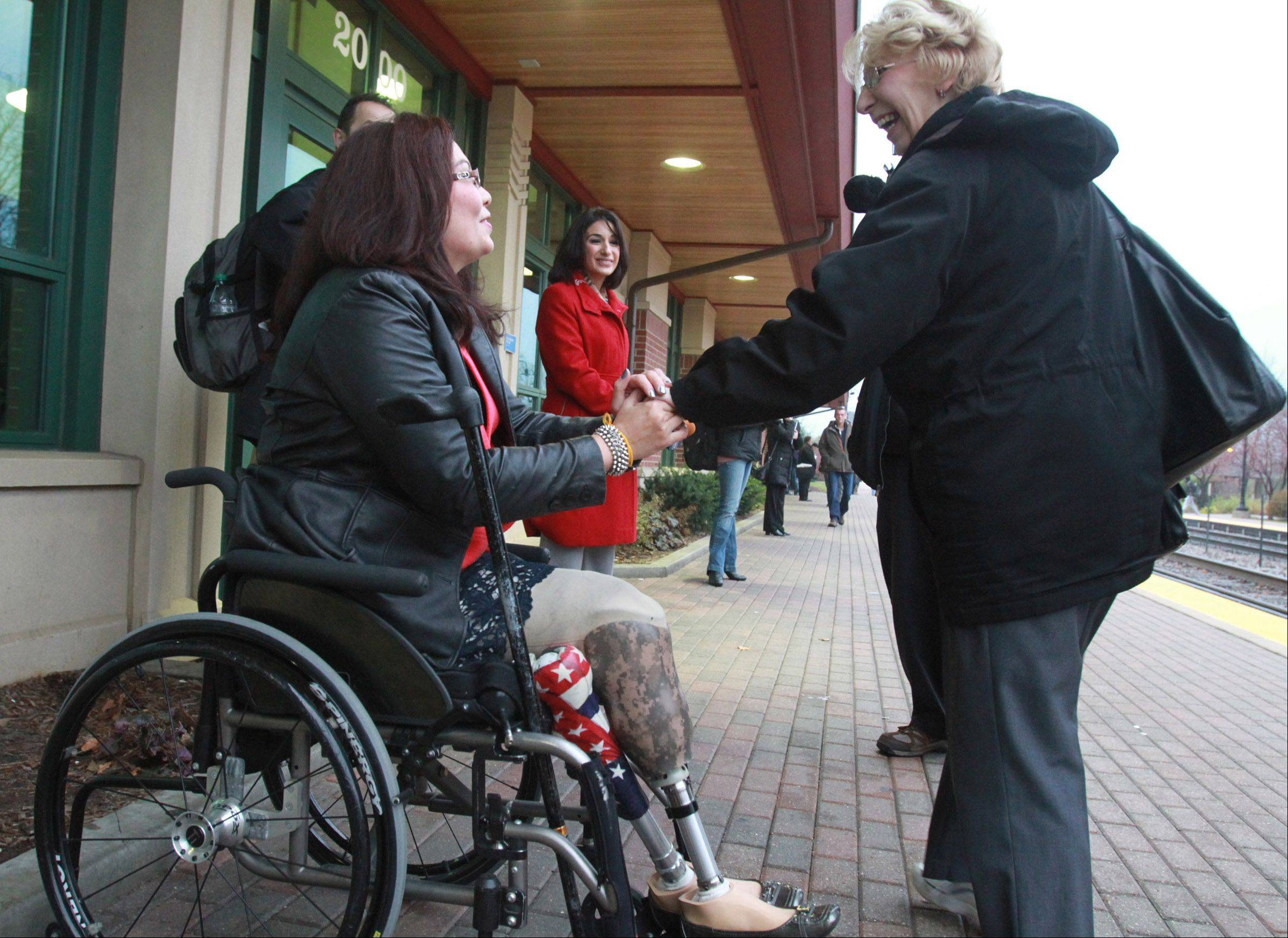 Tammy Duckworth thanks Kathy RePak of Hoffman Estates for her support at the Metra station Wednesday in Schaumburg. Duckworth beat U.S. Rep. Joe Walsh to win election to Congress in the 8th District.