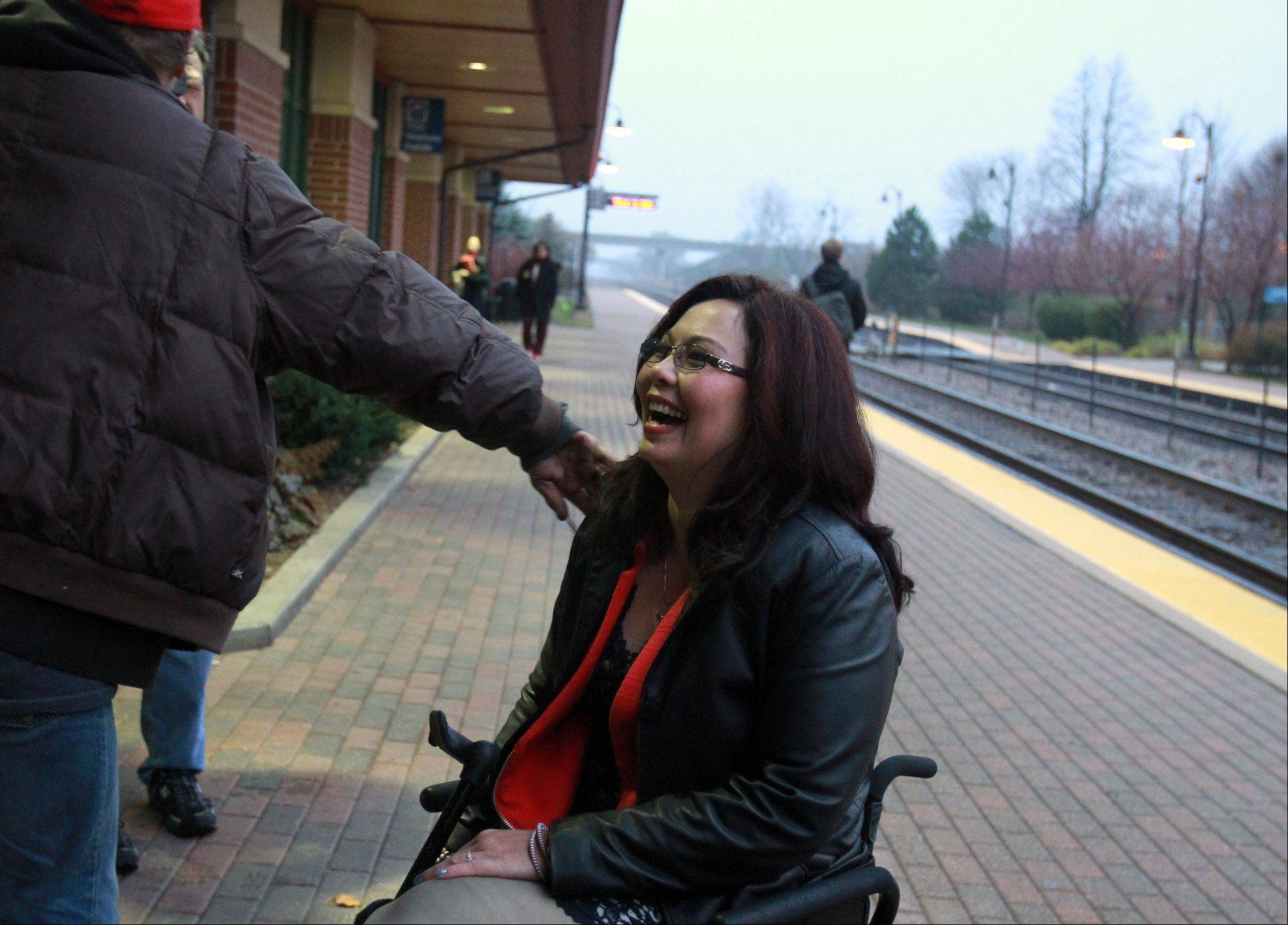 Tammy Duckworth greets people Wednesday morning at the Metra station in Schaumburg. Duckworth beat U.S. Rep. Joe Walsh to win election to Congress in the 8th District.