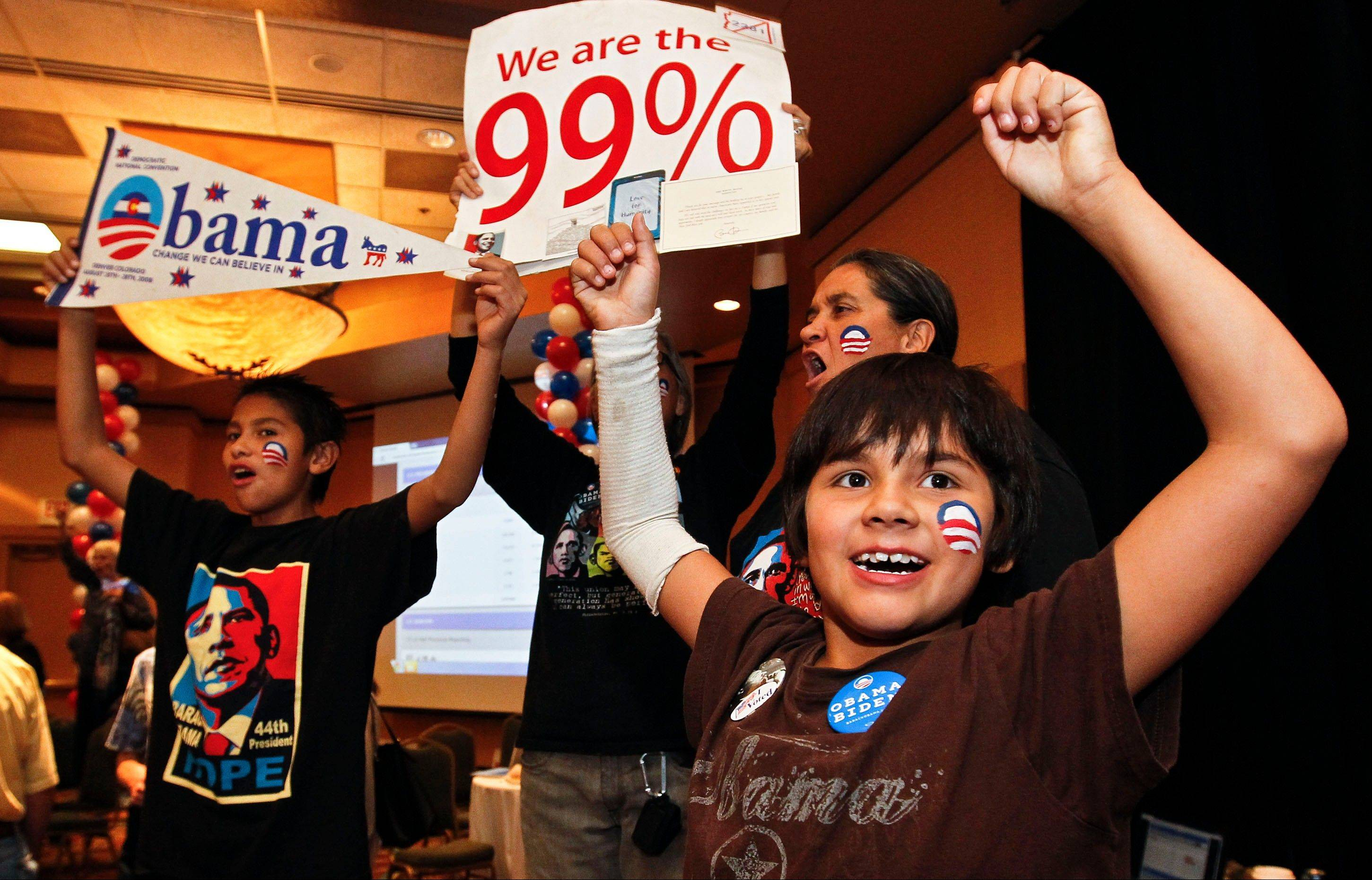 Arizona Democrats of all ages celebrate as President Barack Obama is declared the winner of the presidential race at a Democratic Party gathering, Tuesday, Nov. 6, 2012, in Tucson, Ariz. Younger and minority voters helped put President Barack Obama over the top.