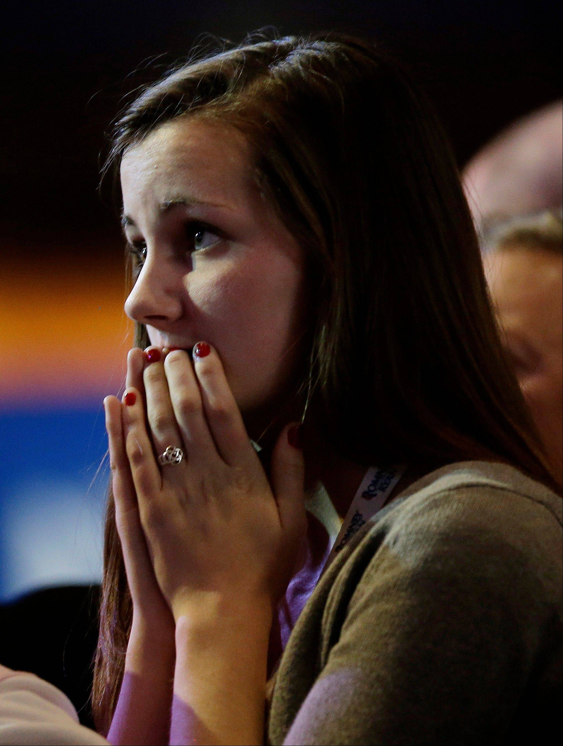 Sixteen-year-old Aly Hansen, from Amherst, N.H. watches vote results displayed on a television screen during Republican presidential candidate and former Massachusetts Gov. Mitt Romney's election night rally, Tuesday, Nov. 6, 2012, in Boston.