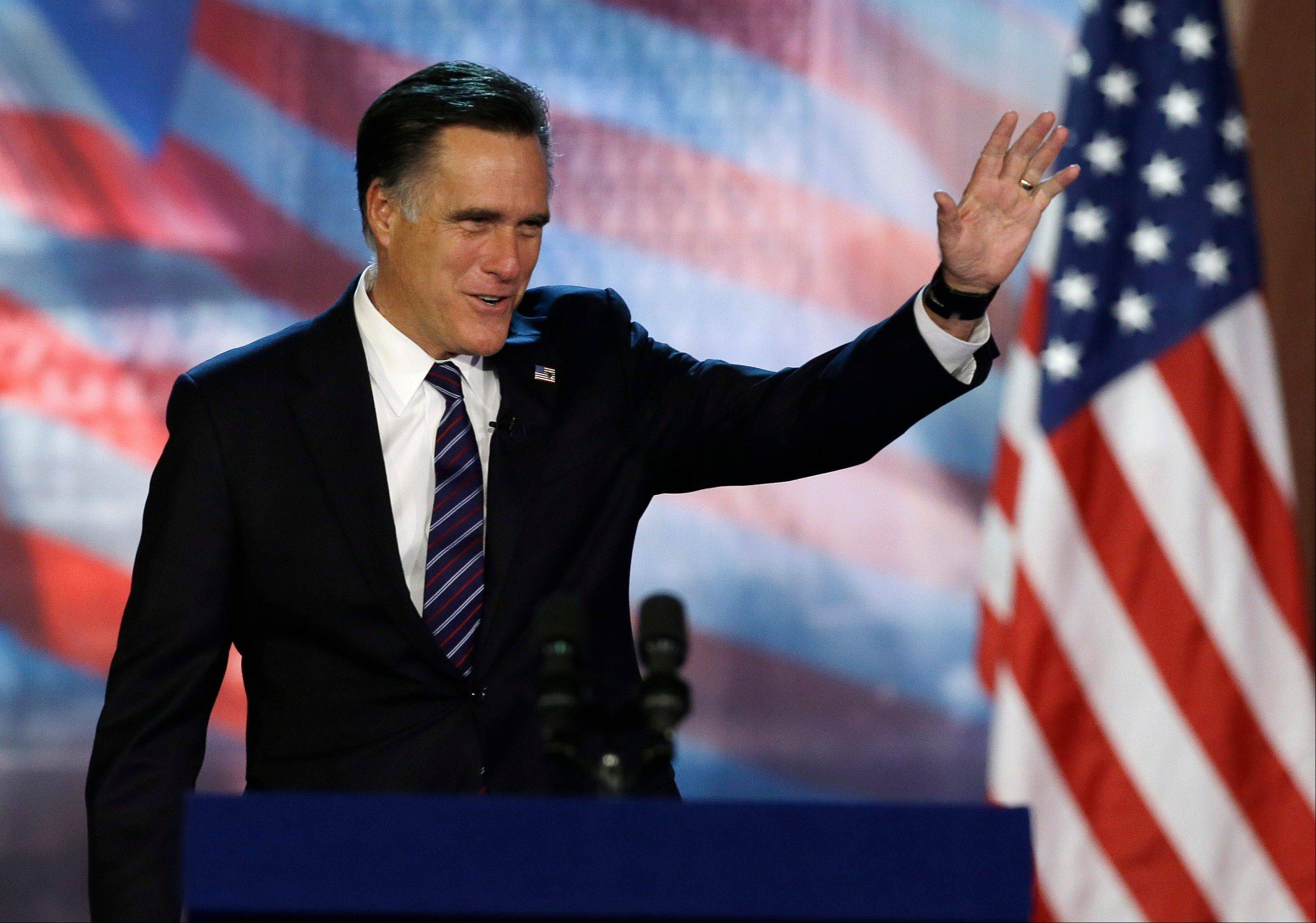 Republican presidential candidate and former Massachusetts Gov. Mitt Romney waves to supporters before conceding at his election night rally, Wednesday, Nov. 7, 2012, in Boston.