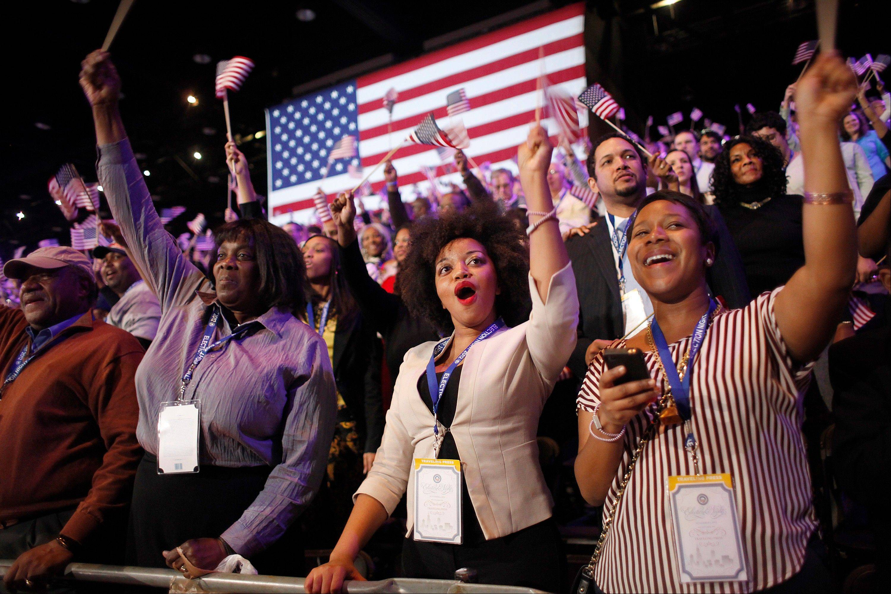 Supporters of President Barack Obama react to favorable media projections at the McCormick Place during an election night watch party in Chicago on Tuesday, Nov. 6, 2012.