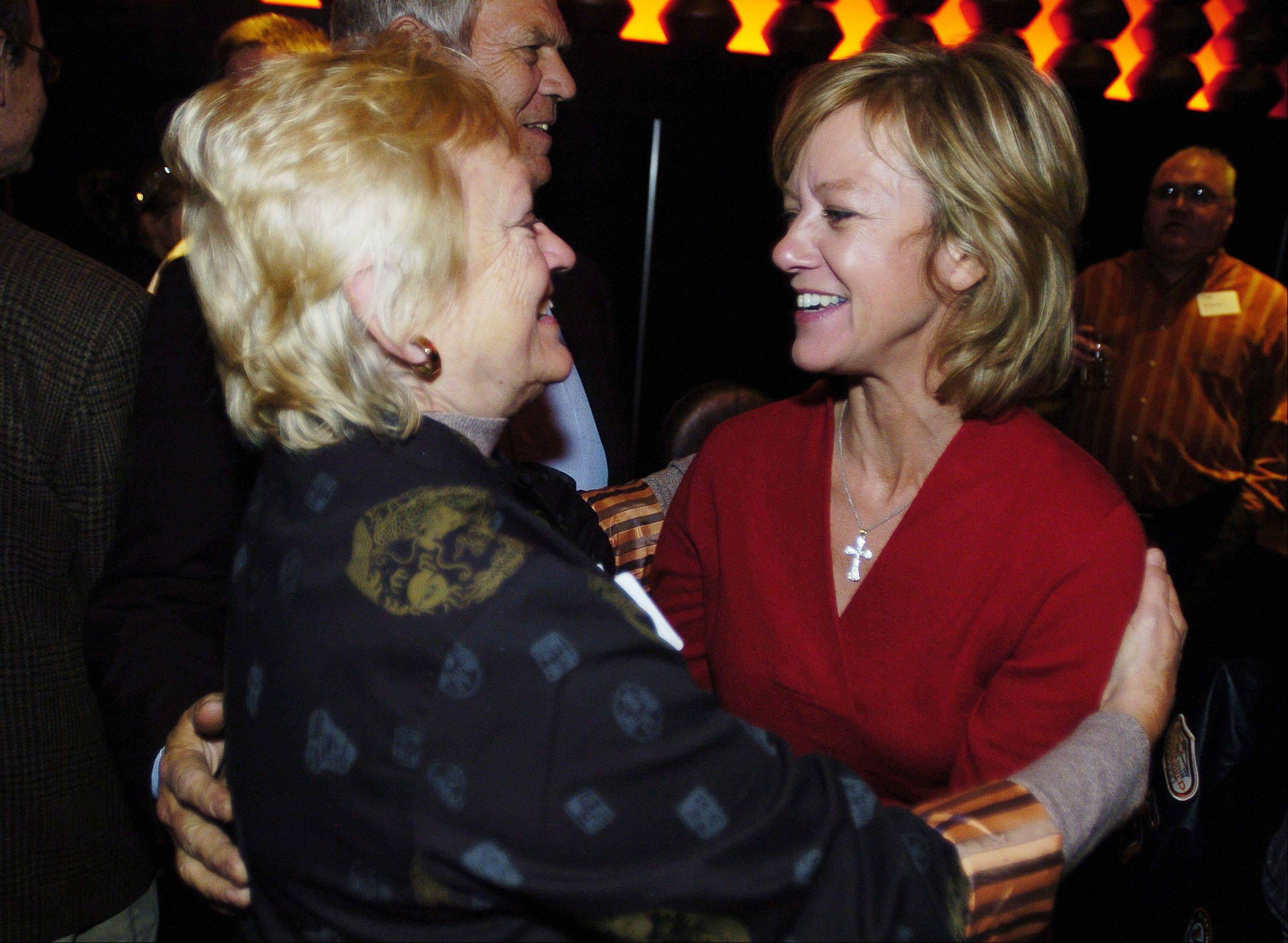 Ginger Johnson of West Chicago ,left, hugs 42nd House District candidate Jeanne Ives at Wok n' Fire in Wheaton Tuesday. Ives won the seat.