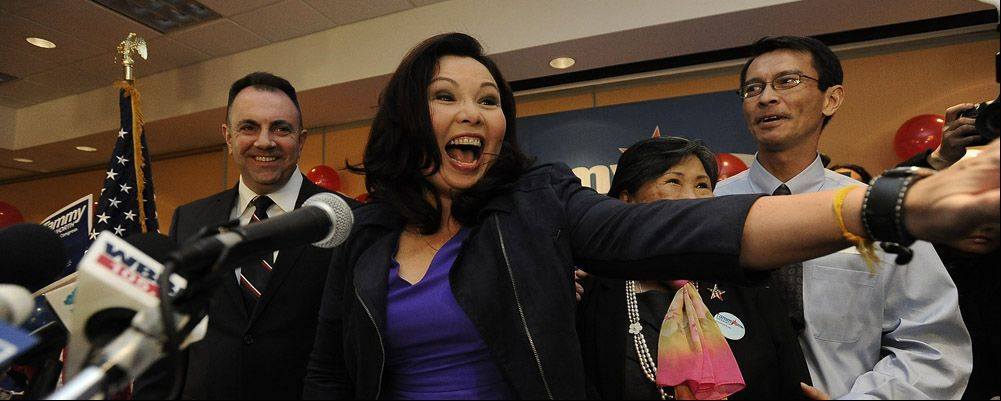 8th Congressional District candidate Tammy Duckworth celebrates victory at her campaign headquarters at the Holiday Inn in Elk Grove Village with her husband Bryan Bowlsbey, mom, Lamai and brother Tom.