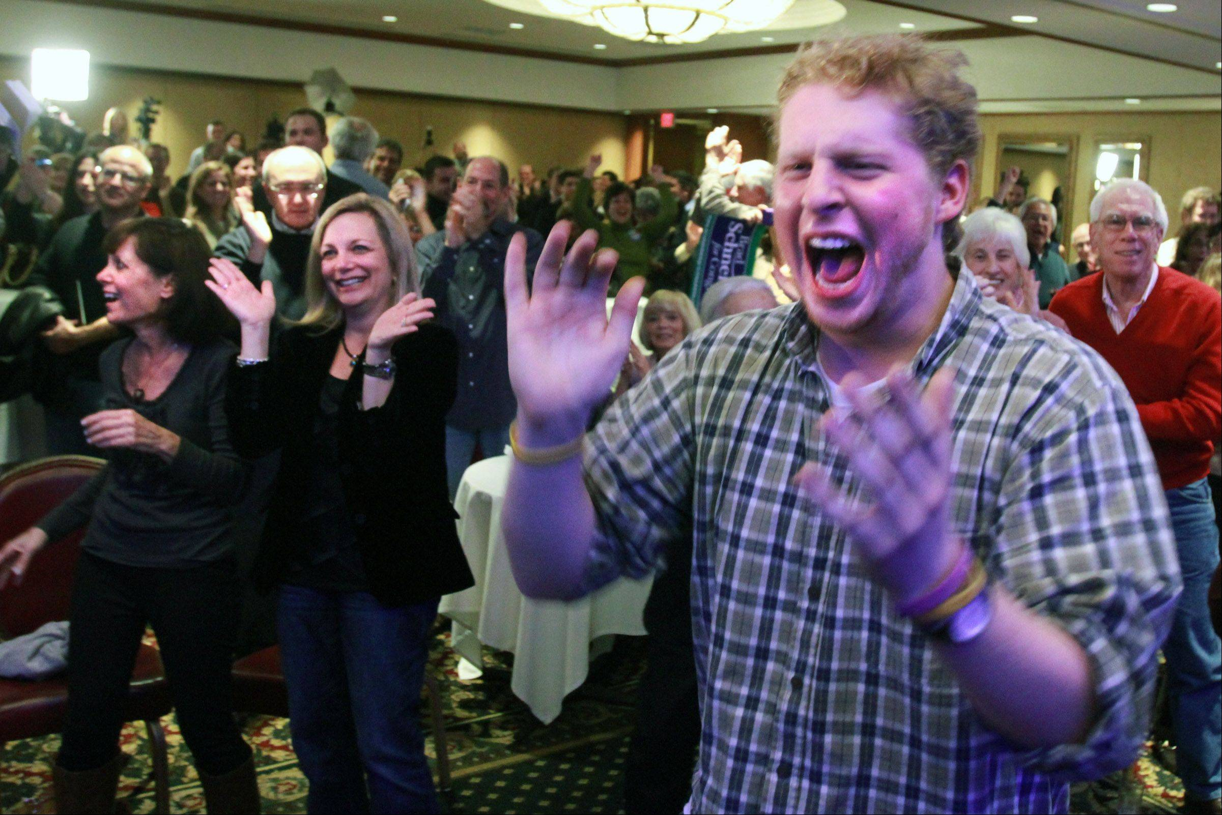 Nat Brautigam of Vernon Hills reacts during a Brad Schneider Northbrook election night party, as CNN announces Obama has won the Presidential election.